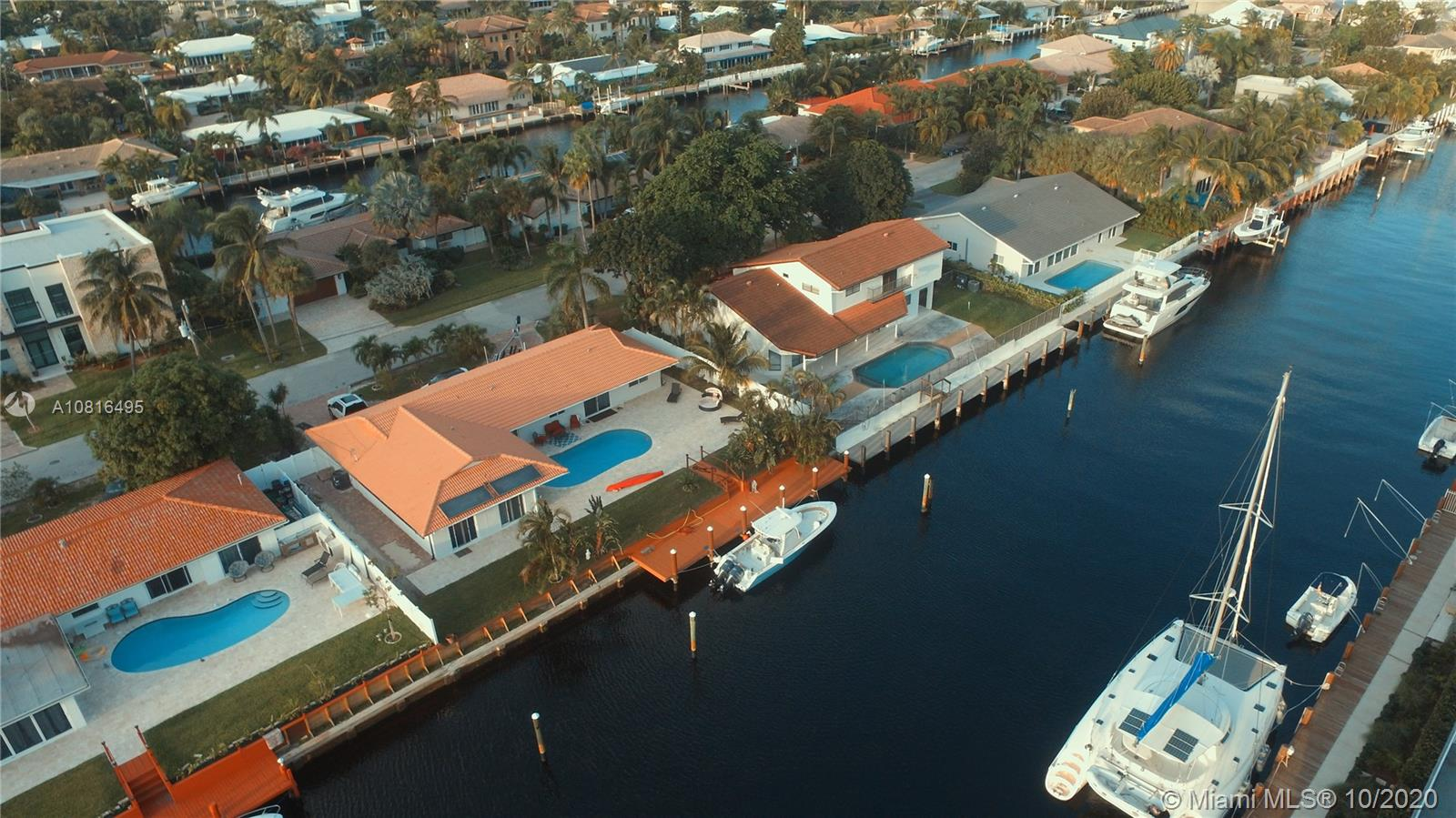 Attractively renovated waterfront home in Coral Ridge. 4 bedrooms 2 baths with split bedroom floor plan. House features new kitchen with quartz counter tops, stainless appliances, tiled floors; new bathrooms, new dock 80 ft dock with 100ft of water frontage. Park your boat by your house and live a dream. No fixed bridges, ocean access. Many restaurants near by. Excellent infrastructure of the area with walking distance to the ocean, mall, restaurants and shops. Excellent location. Dining, Living and Lounge Areas open to Pool. House features Impact windows/doors and a 2 car Garage. Nearby Coral Ridge Country Club Golf, dining, shopping & beach.
