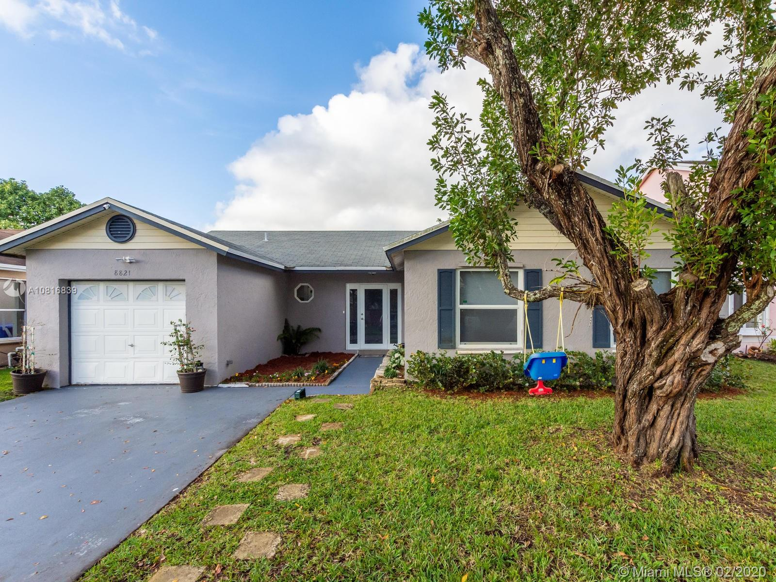 3/2 in a quiet community, with many upgrades!  Remodeled kitchen with beautiful quartz countertops and new stainless steel appliances, hurricane impact windows and doors, new A/C with Honeywell SMART Thermostat, large laundry room with new washer and dryer, bathroom sinks and cabinets updated, and converted garage with A/C that could be used as an office, gym, workshop, or game room. Tankless water heater and attic is insulated.