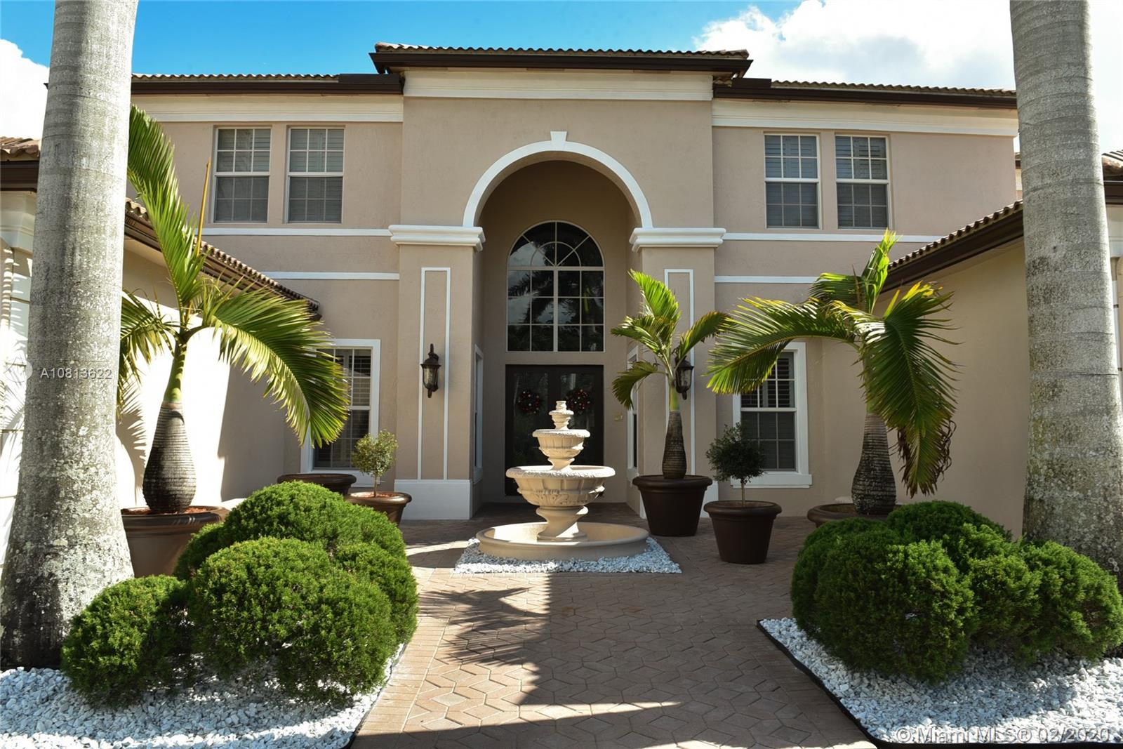 "A STUNNING 2 STORY HOME IN GOLF GATED COMMUNITY @ DESIRABLE DBL GATED ""THE ENCLAVE"" AT GRAND PALMS GOLF & COUNTRY CLUB. HOME WITH 5 bed, 5.5 bath, PLUS FAM & BILLIARD ROOMS.CIRCULAR DRIVEWAY,