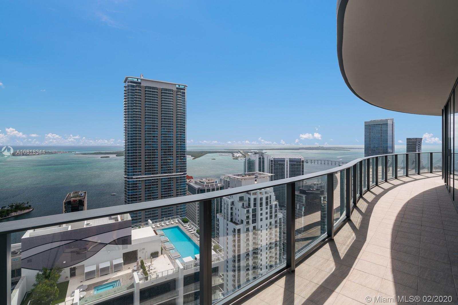 Unobstructed views surround this spectacular Penthouse apartment, situated high atop the Flatiron, Ugo Columbo's hottest new luxury building on Brickell. Perched on the 59th floor, extraordinary unobstructed views of the ocean, bay, and Miami skyline, envelope every room. Featuring, a wraparound balcony, upgraded developer finishes, ceramic wood floors, motorized shades throughout, and Italian custom finished closets. Amenities and services  include, two pools, state of the art fitness center, spa, and twenty four hour concierge. Flatiron Brickell is an oasis of luxury located in the heart of Brickell.