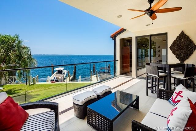 """Private, unique home. Walk out your door to your own private dock! Spectacular wide open, unobstructed  bay and ocean views. Owners have made improvements that exceed the standard for waterfront living for now and the future. Completely reworked to contemporary perfection. Beautiful glass elevator from garage level to top floor. This is guard-gated community with a beautiful pool area, tennis court and sunset to sunrise roving patrols. Ideally situated in Miami's most desirable neighborhood North Coconut Grove. Down the street is gorgeous Kennedy Park. Rent a nearby scooter, walk, ride your bike or take the """"Freebee"""" to dining, entertainment, shopping & sports. Minutes to Brickell, Key Biscayne, seven miles to MIA, two miles to I95.--New roof 2018, electronic blinds. Room for 7 cars!"""