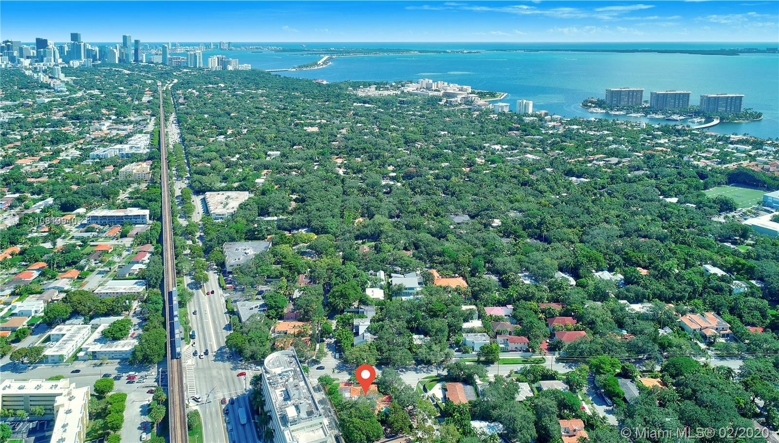 Large Single Family Home on a large Corner Lot, with 6 Bedrooms and 5 Bathrooms in the Coconut Grove Area.