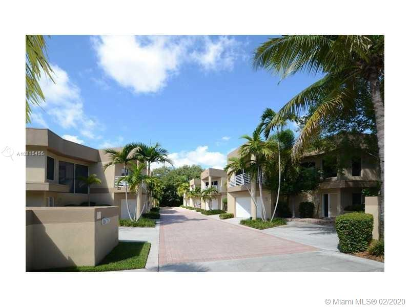 Full of potential stunning townhome with garage, private community pool. Centrally located steps to the famed Las Olas, short walk or bike ride to the beach. Pet friendly community with no rental restrictions. Remodelled few years back two story townhouse offers paved private patio accented with plants, impact windows, newer A/C, washer and dryer, custom cabinets, granite countertop. First floor has tile floor and a powder room, second floor has hardwood floor and two bedrooms and two bathrooms. Guest bedroom has a balcony. The den can be used as a work space or third bedroom.