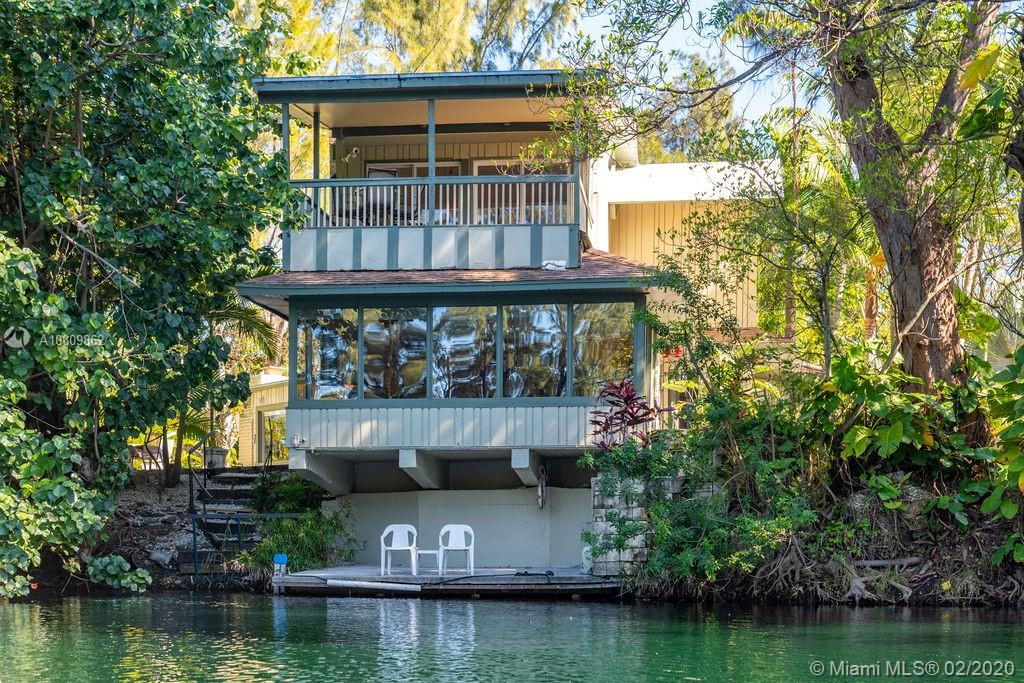 """LAZY LAKE GATED ESTATE rarely comes on market. Tropical gardens filled with fruit trees & wildlife ensure complete privacy surrounded by a lake stocked with bass. Estate opens with a long driveway that leads to the home and large pool. The property is over 1/2 an acre. This 'three-bedroom-three-and-half-bathroom has marble, wood and travertine floors throughout. On first floor, fireplace welcomes guests into a large living area overlooking the water. Kitchen has a 'GAS STOVE and OVEN""""' and a """"BRICK OVEN"""" for those bread and pizza lovers. Separate laundry area too. Two very bright bedrooms one with en-suite and one with separate bathroom are on the first floor. On the second floor, a very large bedroom with high ceilings and private en-suite lead to an outdoor sitting area facing the lake."""