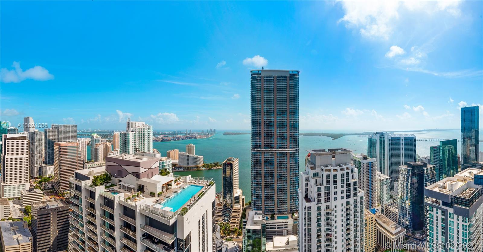 Worldclass views from this 3 Bed + Den/3.5 Bath Lower Penthouse at Brickell Flatiron with higher ceilings.  Italian Porcelain floors, hidden hinge doors, Snaidero kitchens, and a great floorplan create an incredible home in the sky.  Come see the rooftop pool, spa and fitness center with Pilates/yoga and aerobics studio, private steam and sauna facilities.  Some of the other amenties include a children's play area, game room, movie theatre and recreation rooms. All in the heart of Brickell.