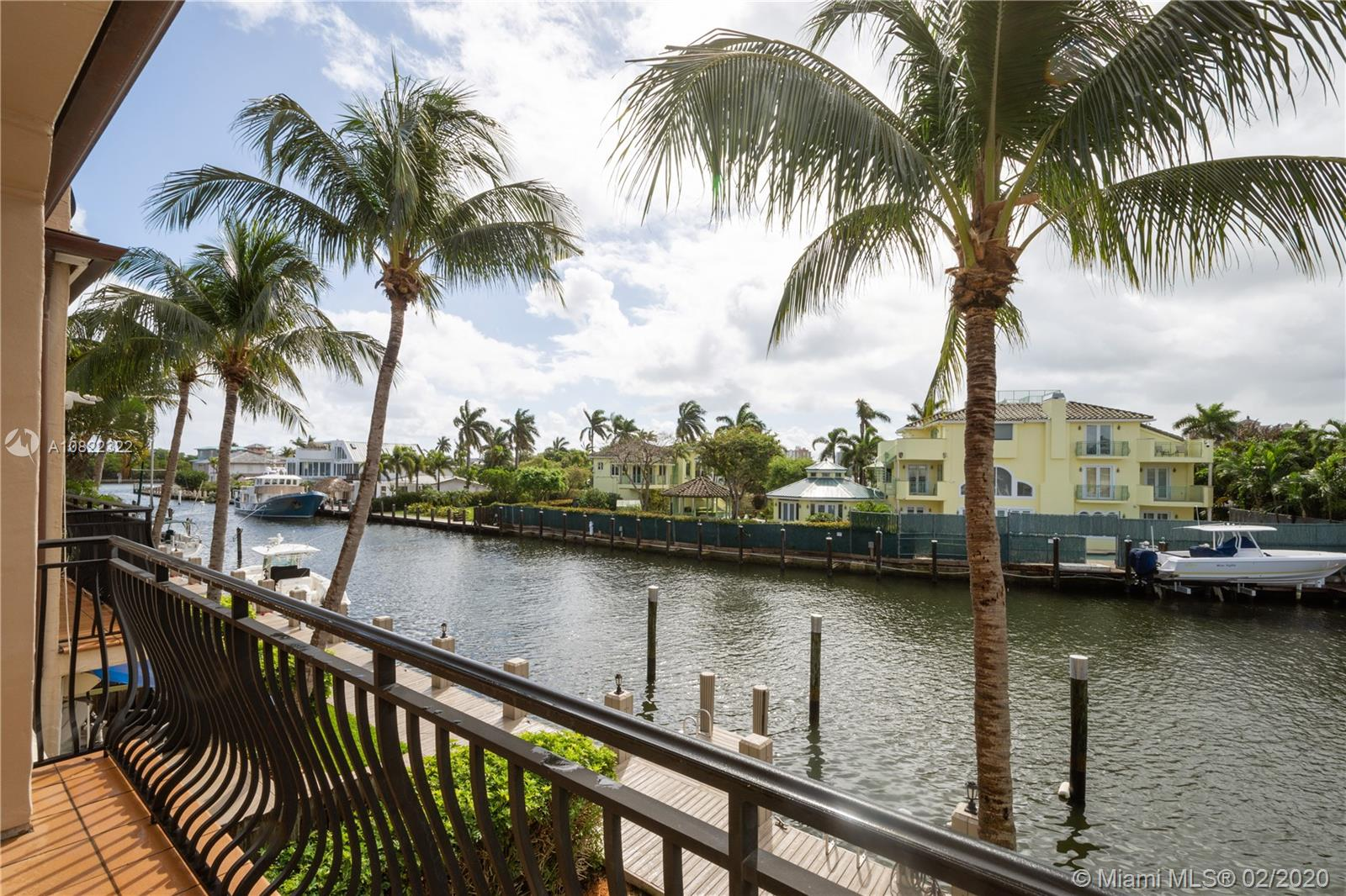 "NO FIXED BRIDGES (Deep Water) Private Dock allowing for 30'-40' Boat right out back! This Magnificent Townhome offers 3 Beds, 2 Full Baths, 2 Powder Rooms. Private Interior Elevator to whisk your Guests to SPACIOUS Roof Top Deck w/ Outdoor Bar & Expansive views of Intercoastal, Ft Lauderdale Skyline to help keep the Party going! LOADED with Natural Light, and Recessed Lighting throughout, Built in 2002 w/ Integrated ""Smart Home"" Technology. Master offers Balcony overlooking Intercoastal, dual closets, seperate Shower and Oversized Spa Tub. Pavered Drive leading to 2 Car Garage, accommoding 2 add'l Cars. 2nd Floor Laundry Room, 2 Zone A/C, Desirable Coral Ridge Enclave w/easy access to Yacht Club & Bayview Elementary, Beach, Shopping & Dining. Dock includes Power and Water, BRING THE BOAT!"