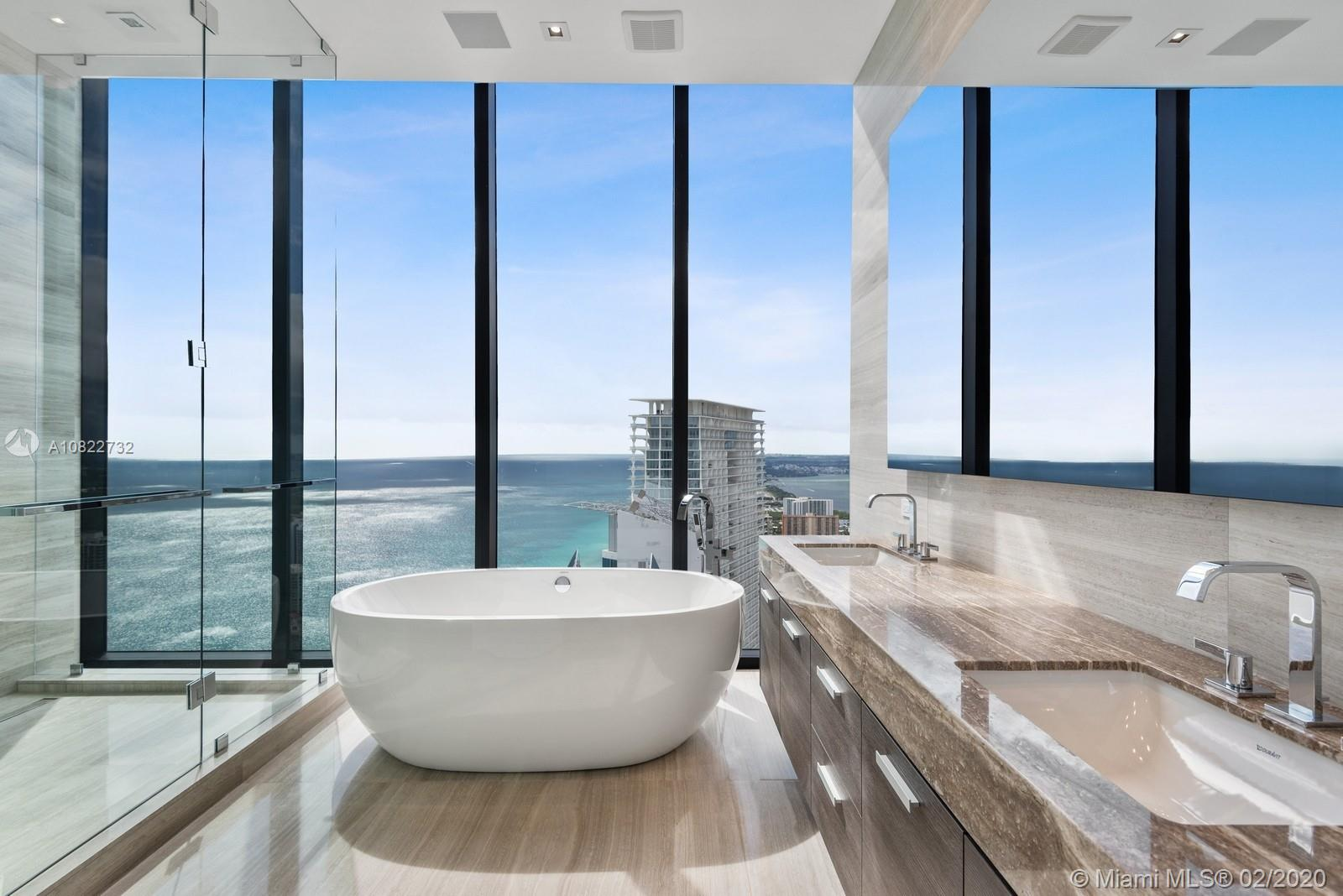 Welcome to a truly unique Boutique Residence of MUSE.  High above any neighboring buildings, you may find yourself living in A One-of-a-Kind, Luxury Smart Home on the 47th Fl.  Which offers you an unobstructed Panoramic Ocean & Intracoastal views from every room.  This 2BR +Den, that can be converted into a 3RD BR, boasts 3 Full Baths.  You will find exquisite marble flooring throughout the unit, surrounded by wall of windows along with 12ft. ceilings.  Top-of-the-line appliances such as WOLF & Sub-Zero and fixtures Dornbracht & Duravit makes this a remarkable home.  Outdoors living consists of a 60ft wide and 36ft deep balcony with a Summer Kitchen for entertaining year round.  Enjoy the finest Amenities such as the Infinity Pool & Lounge, Spa, Gym, Beach Service & Resort like Concierge.