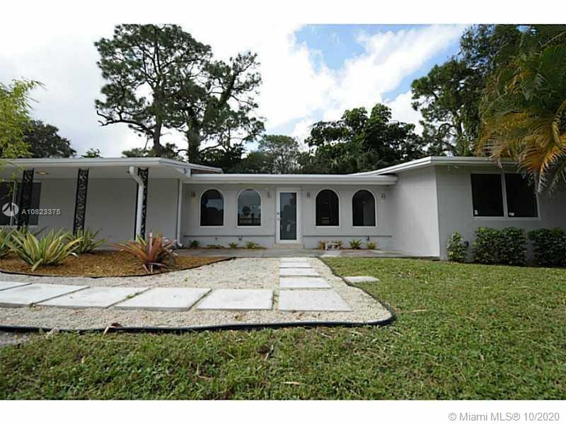 """Imagine Living in this deeply renovated """"mansion"""" for the price of a smaller house, almost 4000 SqFt in 1/2 ACRE+ all in ONE LEVEL, Private fence separates you from the world, 4 bedrooms 3.5 baths, Newer Kitchen Cabinets, counter tops, appliances, newer Baths, Office/den, Media Room/Family Room, Spacious Laundry Room, marble tile flooring, marble and laminated wood, shed/storage detached, Covered Garage 1131 Sq.FT HUGE! Bring up to 8 cars and w PIT for enthusiast. Huge Yard excellent for parking additional vehicles/boats. Entertainers Home! **New Roof installed 2017. Both AC units replaced 2014!"""
