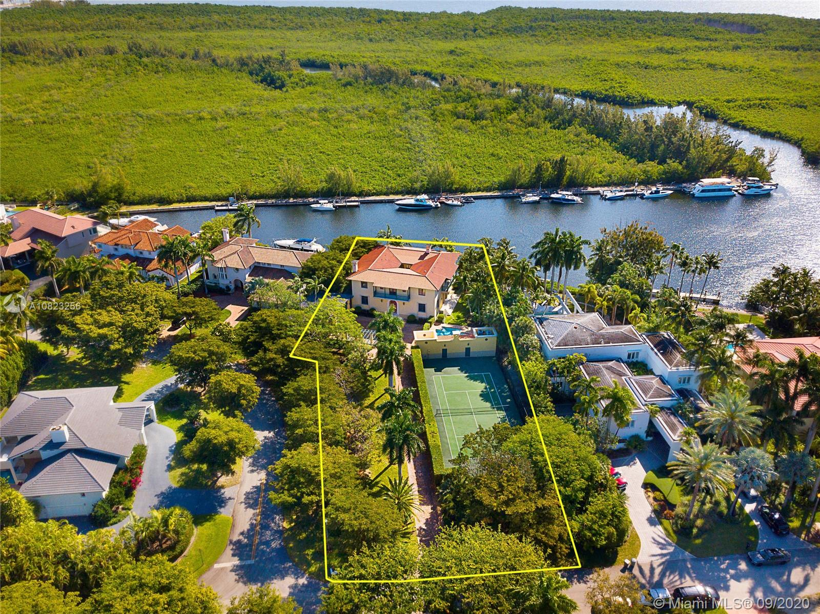 Custom-built waterfront home ideally located in the guard gated community of Hammock Oaks. Situated on a 40,000-SF lot with gorgeous views of protected Matheson Hammock, & only 1 bridge to the bay. Beautifully designed with grand spaces, 12' ceilings, living room with fireplace, dining room, eat-in kitchen, romantic courtyard, & great room running the entire back of the house facing the water views. This majestic estate offers 6 spacious bedrooms, & 5.5-baths, including a guest bed downstairs, 4 bedrooms upstairs, & generous master suite with water views, sitting room with fireplace, private balcony, large walk-in closet, & bonus gym off master that can be turned into 7th bedroom. Outside, 36' dock, tennis court, pool, cabana bath, covered terrace, long private driveway & 2-car garage.