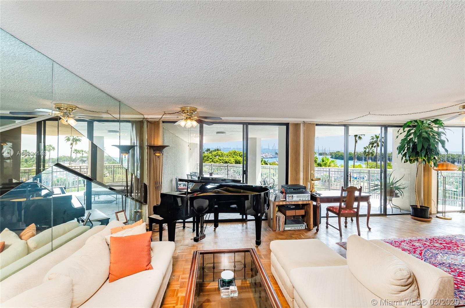 Fabulous Yacht Harbour Condominium prestige & secure building in the heart of Coconut Grove. The spacious living room and open floor plan maximize space. The floor to ceiling sliding glass doors and windows offering natural light and stunning views that gives the unit a bright throughout. Panoramic Biscayne Bay views with totally renovated wrap-around terrace. This originally 3 beds, 2 baths condo has been converted into a 2/2 in order to take full advantage of the captivating views of the Coconut Grove Marina, Sailboats, Biscayne Bay & Key Biscayne. This 2, 387+- SF Unit is walking distance to markets, theater and parks. This location invites to the bright and spectacular lifestyle of charming Coconut Grove: Sailing and yachting, outdoor dining, strolling under the hammocks and nightlife