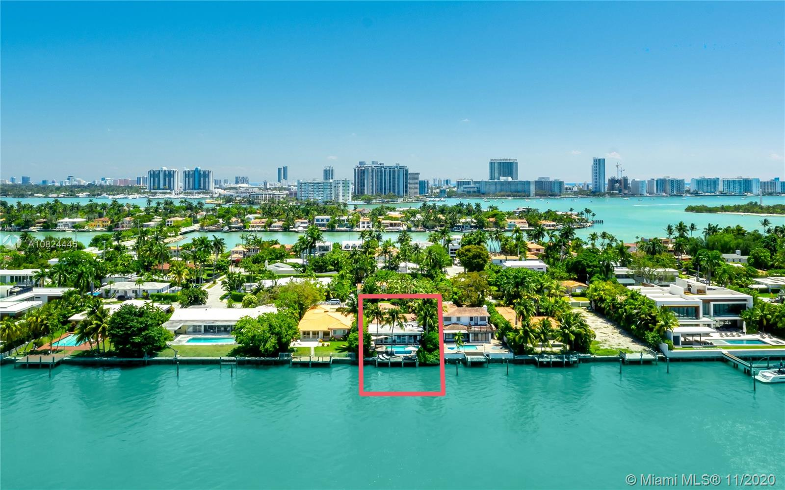 DREAM VIEW OF MIAMI SKYLINE FROM THIS RENOVATED WATERFRONT VILLA WITH A BOHEMIAN VIBE! Move right in or Build NEW on this PRIME 10,500 SF LOT with 60' on the Water. Bayfront Negative-edge Pool wrapped with Ipe Wood Deck. 4 Bedrooms + 4 Baths + Study in Open Floorplan for Hanging Out & Relaxing over Amazing Sunset Vistas. Hardwood floors; Renovated European Kitchen in dove grey + white Marble Countertops, Subzero Refrigerator, Wine Cooler & Gas Cooktop. Raffia & Linen textured wall coverings exude a wonderful Beach House Atmosphere. Romantic Pathway Entry through Tropical Lush Gardens. Walled & Gated for Privacy and Security. Parking for 4 Cars. Enjoy Young & Hip Venetian Islands just blocks from The Standard Spa & Hotel, Sunset Harbour, Lincoln Road.
