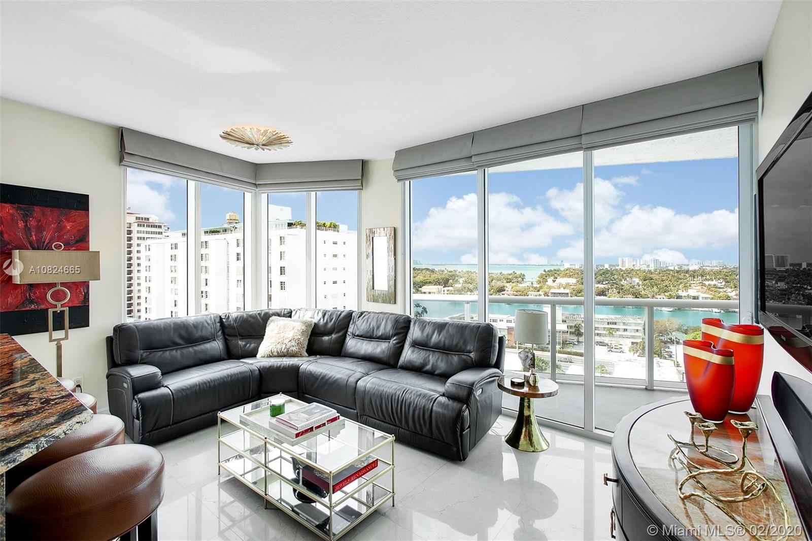 A modern furnished 2 bedroom, 2 bathroom corner apartment at the Bel Aire Miami Beach, a newer luxury oceanfront condo in a great neighborhood.  This apartment has marble flooring throughout, and all rooms have floor-to-ceiling windows.  Enjoy ocean, intercoastal and city views from this open floor plan and from two spacious balconies. The unit comes with four parking spaces!  The Bel Aire amenities include direct beach access, a heated pool, gas grill, game room, fitness center, 24-hr security, and valet services.  You will love this apartment.  Easy to show.