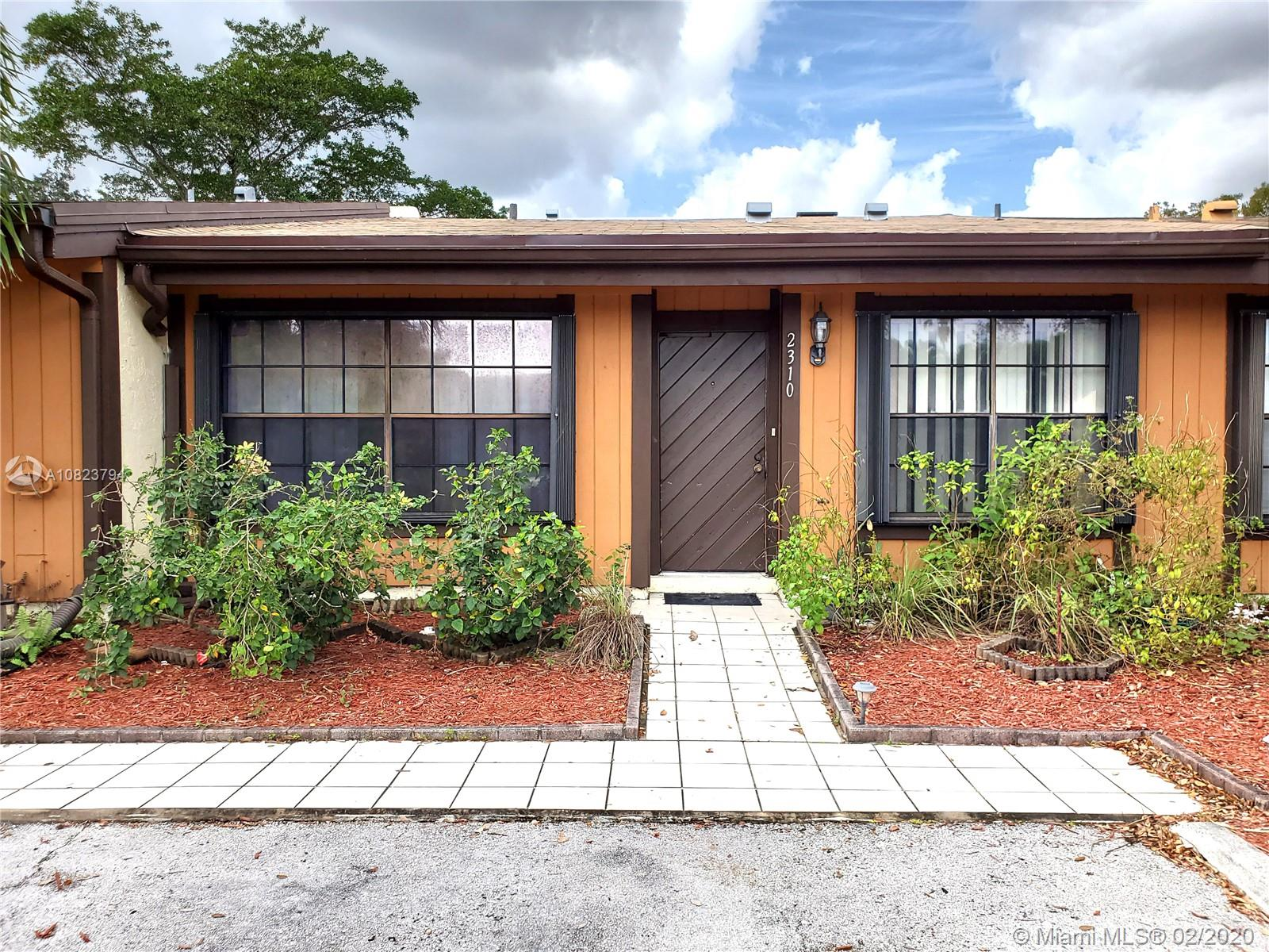 Fixer-Upper in sought after Cedarwoods at Pembroke Lakes Townhomes. Roof recently replaced with permits. Needs TLC to replace bathrooms and kitchen. Cedarwoods has low HOA maintenance fee. High wood ceiling. Two designated parking spaces in front of the unit and guest parking nearby. Accordion hurricane shutters. Roof replaced in November 2019. Centrally located. Broker is a party to the Seller. Rental after two years of ownership.