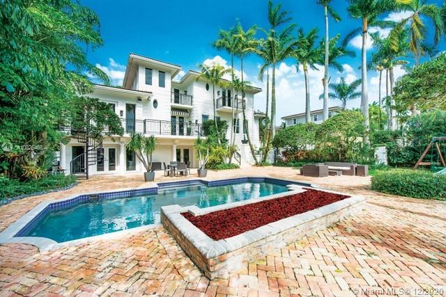 BIG PRICE REDUCTION, in GATED community, Treasure Trove in Coconut Grove. Majestic surroundings, in ideal central location. 5 bd/5.5 w/ensuite baths. Beautiful master bedroom with views of the Coral Reef Yacht Club marina and ocean. Large master suite with 2 walk-in closets, 2  home offices, 2 guest rooms, and a playroom. Home was remodeled less than 4 years ago with new roof, 3 new A/C units, impact windows, all new bathrooms, updated kitchen and floors. Contemporary top of the line finishes. Beautiful garden, children's playground and salt water pool. High ceilings, lots of natural light throughout the house. In close proximity to many top rated schools. Near restaurants & shops. 24 hour security walled and gated.