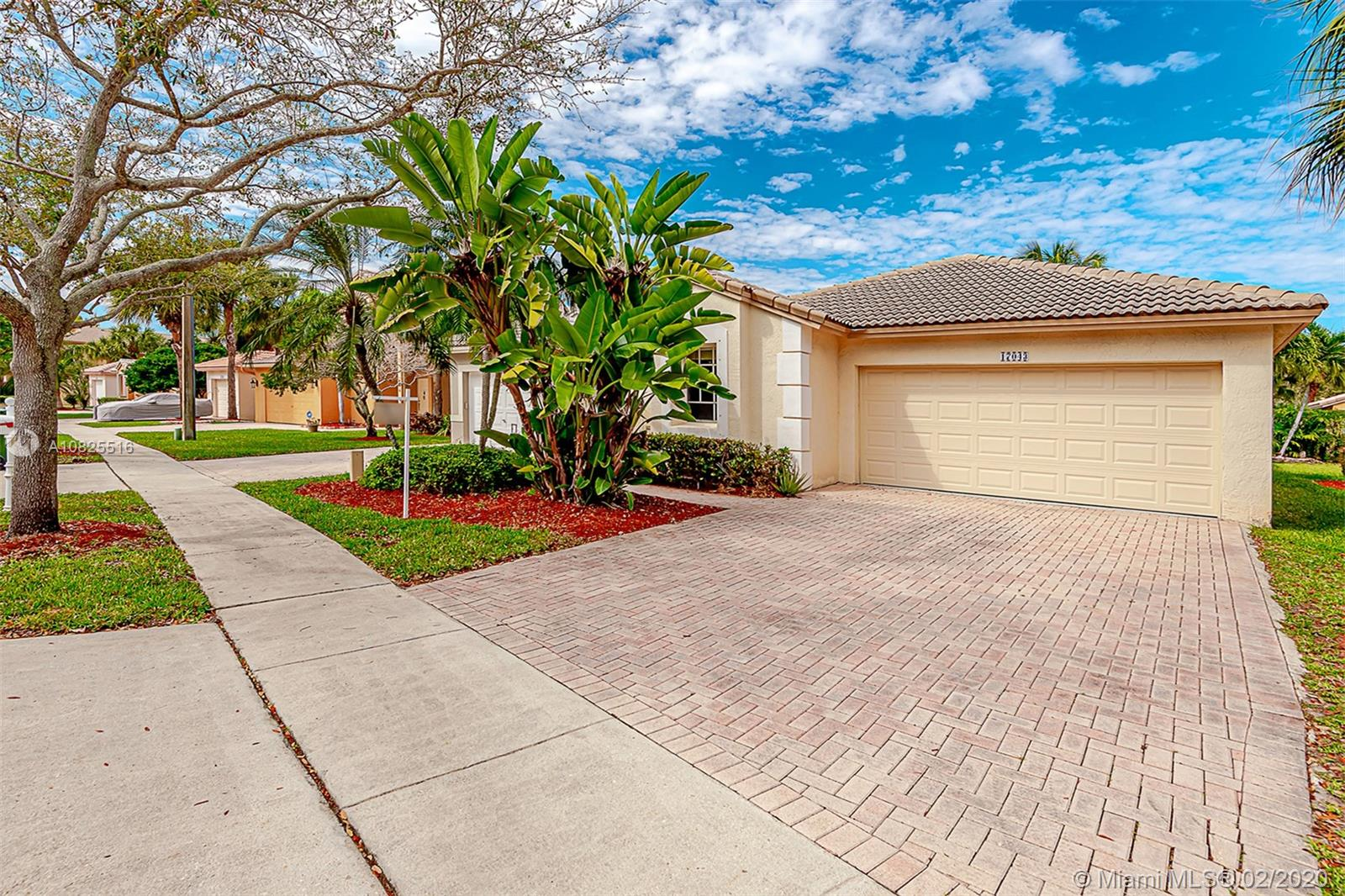 NATURAL LIGHT-FLOODED 3 bed / 2 bath in the resort style community of Pembroke Isles. Wood laminate throughout the main living areas and tiles in kitchen and bathrooms. KITCHEN was remodeled in 2018. NEW AC 2019. All interior walls and ceiling were smoothed down so NO POPCORN! Walking distance to high rated Panther Run Elementary. Great Middle and Highschool. 