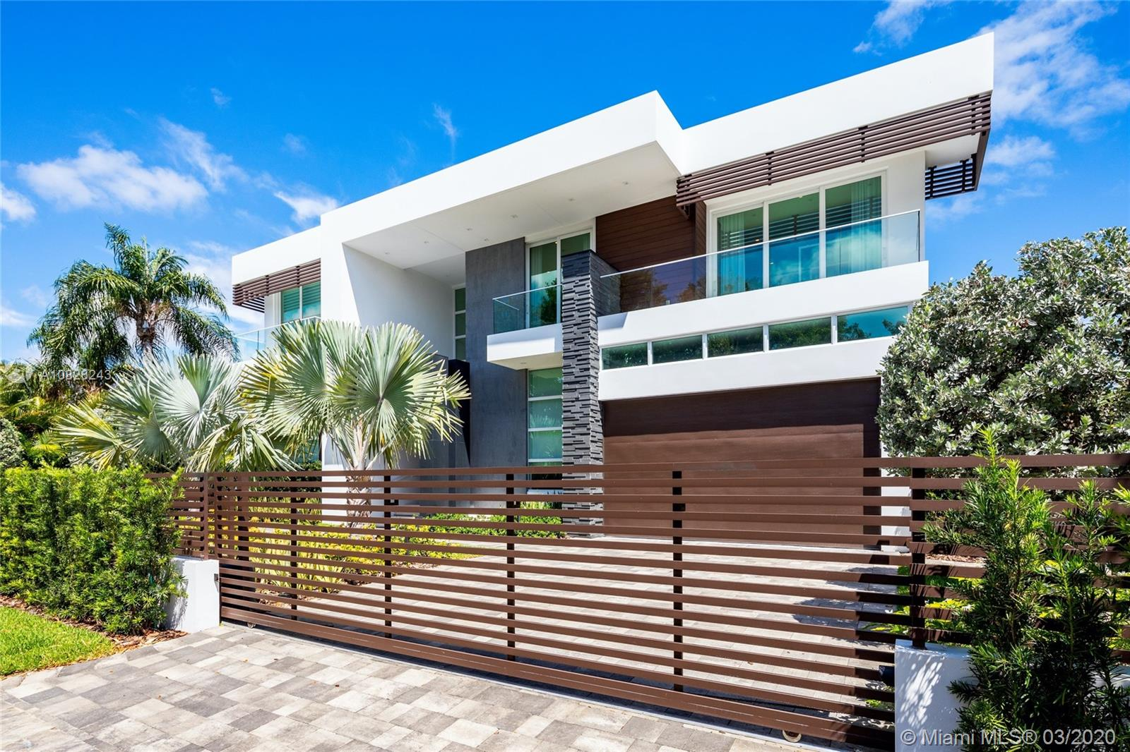Masterfully Built in 2018, this Brand New 6200 SF Tropical Modern offers a combination of sleek Architecture & Bespoke finishes that will be sure to amaze the most discerning clientele. A thoughtfully Designed open layout perfect for lavish entertainment or family enjoyment, this fully integrated smart home features high ceilings, Crestron lighting, full home automation w/ security cameras, Snaidero Kitchen & Vanities, Electronic Window Treatments, Spacious Walk-in Closets w/ Custom Cabinetry, floating staircase & much more. The sleek lines & modern Architecture seamlessly blurs the lines of Indoor Outdoor living, creating your own tropical oasis. The backyard offers an outdoor summer kitchen w/ grill, zero edge swimming pool w/ spa & covered loggia. A+ Location & Top School District.