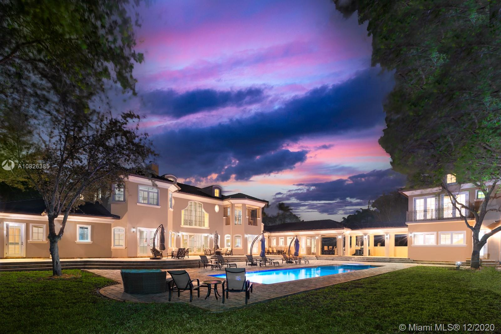 Spectacular 1-acre estate in coveted North Pinecrest featuring 8BR/8.5BA and 9,997 Adj. Sq. Ft. (11,414 total Sq. Ft.). Spacious formal and informal living areas w/ soaring volume ceilings and CGI impact windows/doors. Gourmet eat-in kitchen w/ Viking Professional appliances. Home theater, elevator and gas fireplace. 55' heated pool w/ expansive patio, summer kitchen and loggia to two-story guest house. Walled and gated w/ 3-car garage and whole house generator. Pinecrest Elementary School District.