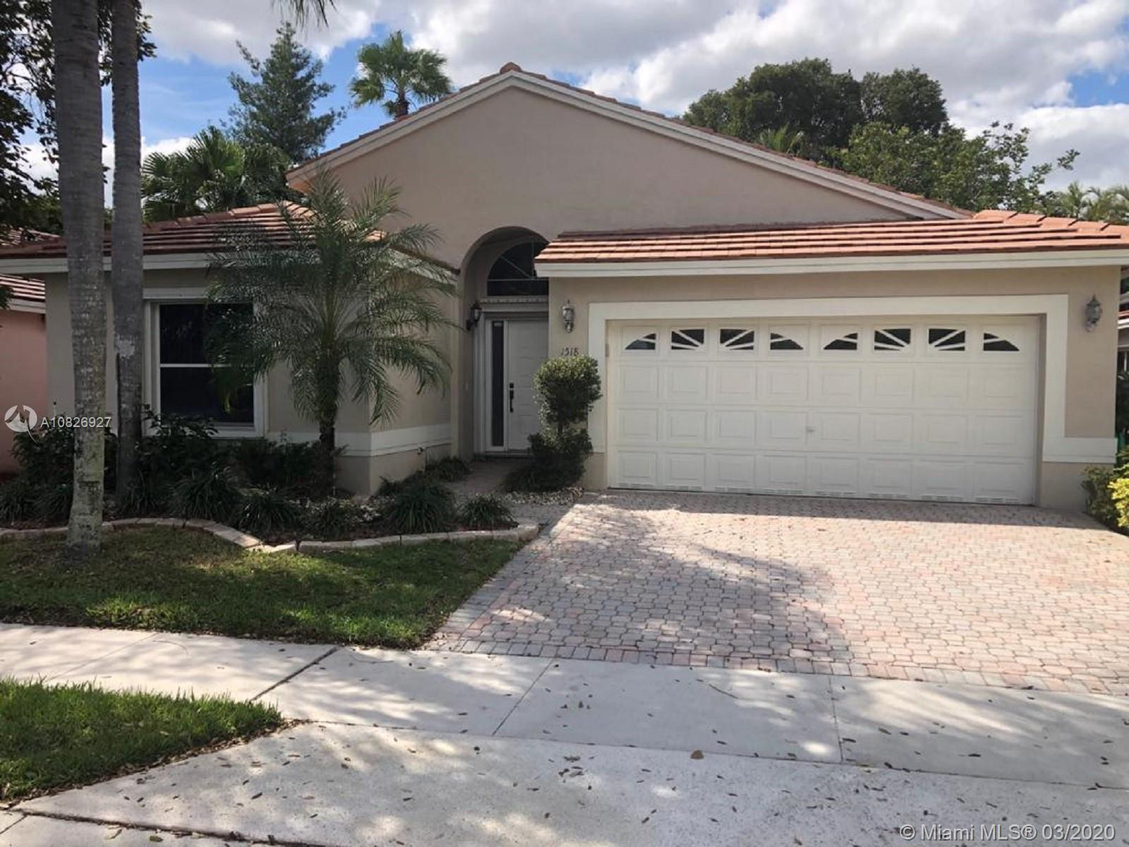 PRICED TO SELL!! THIS ONE WILL GO QUICKLY!  Tropical Paradise in gated golf community. **3rd Bedroom currently den/office** New roof, 7 years old. Assoc covers cable, 24/7 security, alarm, outside landscaping, sprinklers system, exterior painting. Close to I-75, schools, shopping center and restaurants. MOTIVATED SELLER  in process of relocating.. Seller will remove chandeliers, washer & Dryer. *AS IS*