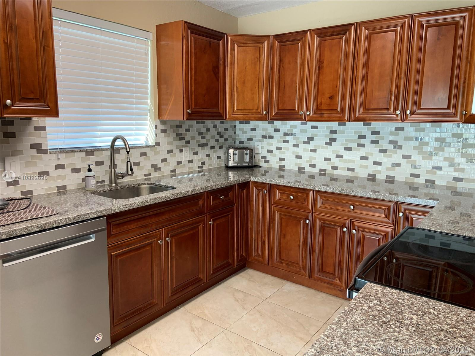Completely remodeled one story single family home with fruit trees and a nice size backyard. Perfect for entertainments, New Central AC, Newer roof, Impact windows, Close to great schools, major highways, shops, places of worship, restaurants, movie theaters, hospitals, Pembroke Mall, Aventura Mall,  supper Walmart, Guitar hotel, Hard rock, casino, airport, and the beaches. Run don,t walk. Easy to show, No HOA fee