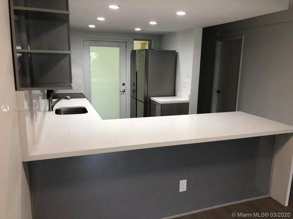 MUST SEE! Spectacular island living. Beautifully remodeled, corner unit, very bright, move in ready! New AC, new appliances, all electrical and plumbing is new and new impact windows and doors!! Great location, quiet street. Beach access at the end of the street.
