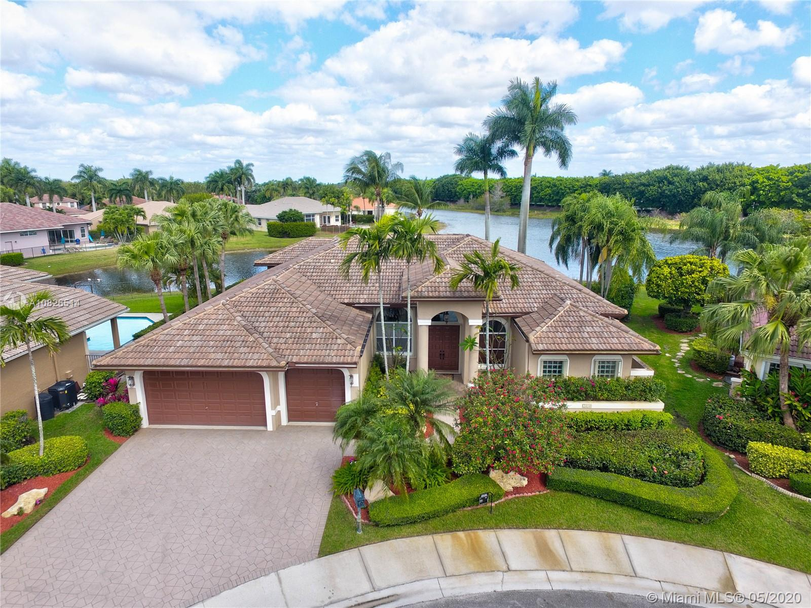 Perfect for you and your family,  A true 5BR, 3.5BA, 3-car garage on more than ? acre w/prof. landscaping. Set on a cul-de-sac, waterfront living with a large screened patio w/ heated saltwater pool and beautiful long lake views in prestigious Weston Hills Country Club.Newer roof (2014). Newly renovated modern kitchen, SS appliances, and breakfast nook. Updated bath, extensive crown molding and ceramic tile floors throughout.Spacious Master Bedroom w/tray ceilings. MB w/dual vanities, soaking tub, and oversized walk-in shower. Separate office/library. Jump on I75 for quick Miami commute, Weston Town Center, Cleveland Clinic. FLL Airport & a Grade A school system. A Golf membership is optional.