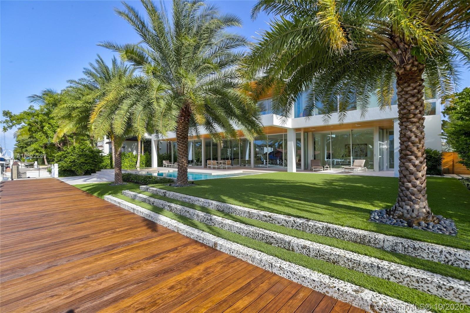 Fort Lauderdale's finest Organic High End Finishes & intelligent Architecture by Bob Tuthill, in exclusive Rio Vista. This modern home offers 100 ft of waterfront w/ new Ipe Dock & Seawall & 125 ft deep lot w/ Salt Chlorinated Heated Pool, Infinity Spa & tropical landscaping by George Keen. Eggersmann German engineered kitchen w/ Miele & Gaggenau appliances, Glass & Lacquer cabinets & Stainless Steel & Carrara Marble Counters. Legno Bastone European Wide Plank White Oak & Limestone Floors, Italian laminated hingeless magnetic doors, architectural reverse Metal Baseboards. Master Suite w/ Downtown Views, Calacatta Gold Marble & Eggersmann Closet w/ semi precious stone. Custom Elevator, Sub Zero Wine Cooler, Control4 Smart Home w/ integrated sound, security & lighting, Motorized Shades.