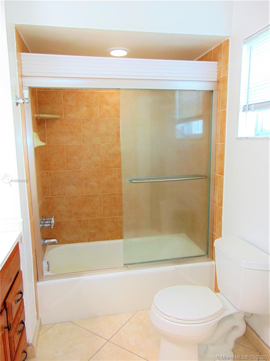 Beautiful corner unit with lots of natural light. Spacious floorplan with 1 bed, and 1.5 baths, plenty of closet space, large terrace with pool view, and storage unit. Tiled and laminated wood floors throughout. Quiet building located within minutes to the beach, Bal Harbor Shops, and Publix. Pool was recently remodeled. 1 assigned parking, and guest parking available.