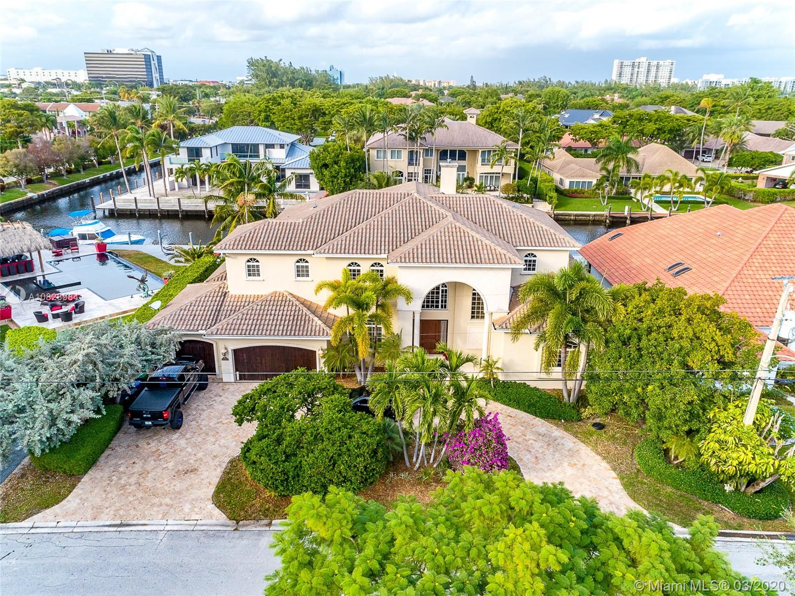 Gorgeous 2-story home. Wood dock with 100 feet of deep water, no fixed bridges. 6 BR, 6.5 BA. 6355 SF. 11,000 SF lot. 3 Car garage, elevator. Gourmet kitchen with eat in area, family room overlooking the water, 2 laundry room.Master suite and office downstairs. master suite with sitting area and morning bar, upstairs 4 additional bedrooms, large covered terrace with water view and loft area. salt water pool, spa & summer kitchen. Entire house freshly painted, new A/C and newly redone, landscape throughout. 5 mins to one of the best private schools Pine Crest.