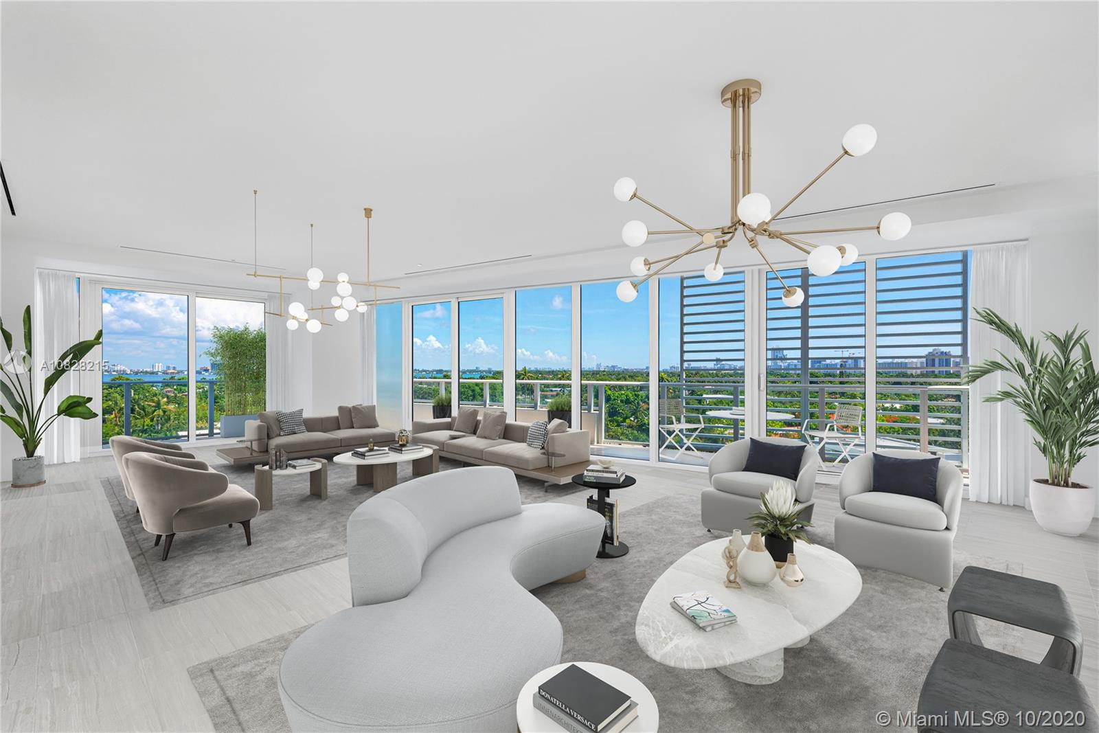 The Ritz-Carlton Residences, Miami Beach offers 111 luxury residences designed by Piero Lissoni. This corner residence boasts walls of glass embracing natural light throughout expansive living spaces and wraparound terrace overlooking Surprise Lake, Biscayne Bay, and Downtown Miami. Exquisitely finished with stone and wood flooring, Boffi kitchen with gas cooktop, Gaggenau appliances, and Zucchetti fixtures. Full-service building managed by The Ritz-Carlton and amenities including a marina, spa, rooftop restaurant and pool. Immediate occupancy.