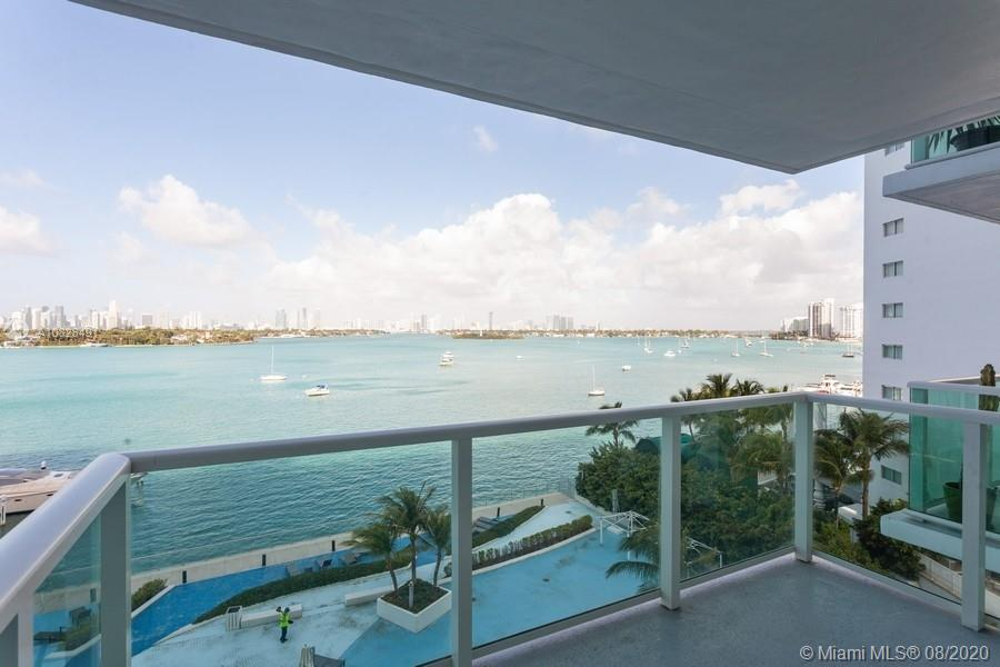 Panoramic Bay view throughout this completely updated paradise. Everything is Brand New. Beautiful Balcony with incredible views of the Bay and Downtown. This unit comes with a coveted parking space. Walking distance to everything. Special assessment to be paid off in full by Seller. Full amenity building,  maintenance includes cable, internet and a spectacular gym. Huge pool and hot tub overlooking the Bay. Newly installed impact windows and doors. Move in ready. To show please call listing agent.