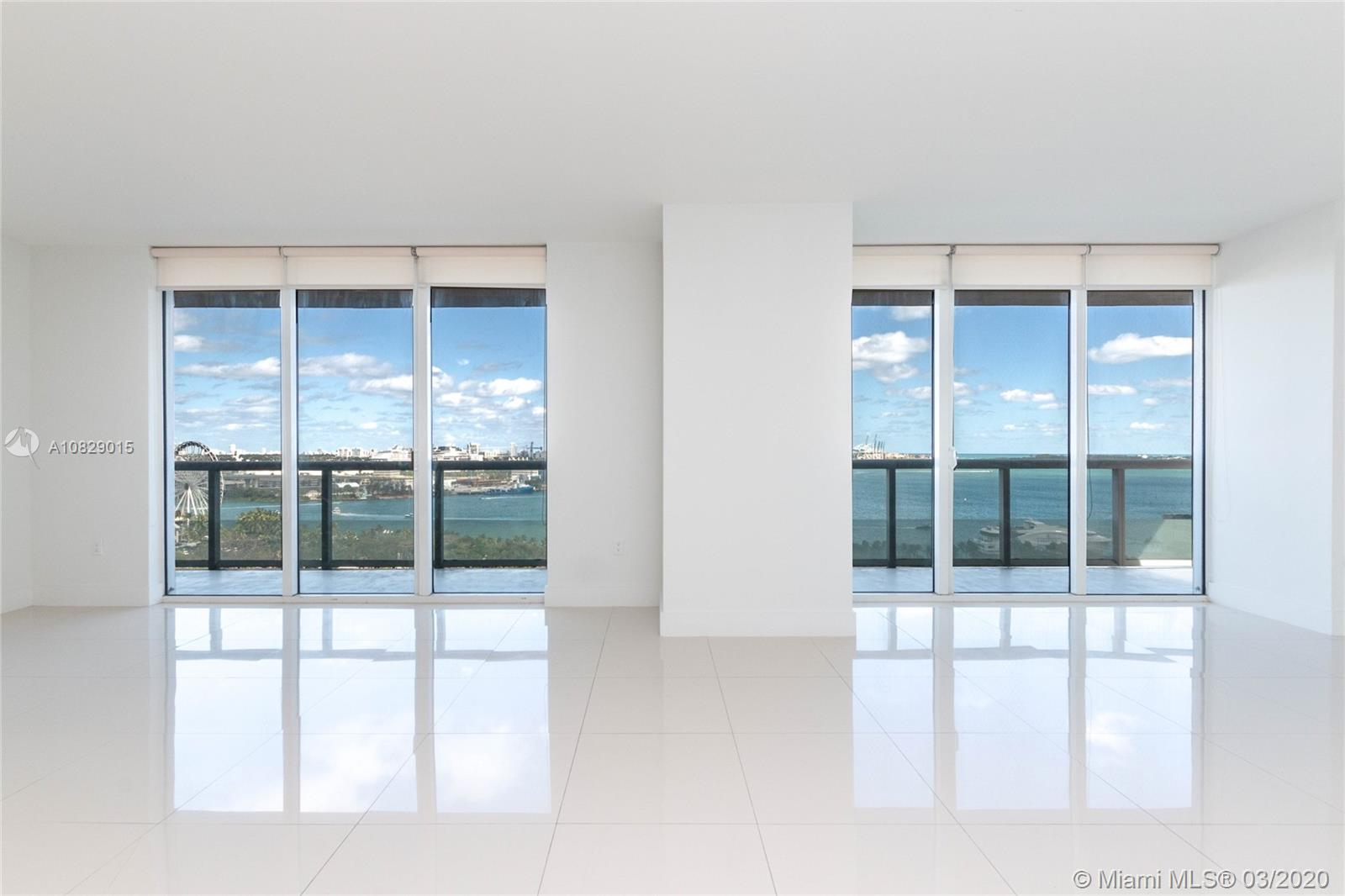 Incredible ocean views, overlooking Bayfront Park , the Port of Miami and South Beach! This spacious 3/2 corner unit has UPGRADED marble floors, Italian kitchen with stainless steal appliances, and wrap around balcony.  The building has great amenities that include gym, pilates, sauna, spa, party room, Olympic size heated pool with cabanas, formal and informal club house, 24 hour security, doorman, valet service and concierge!
