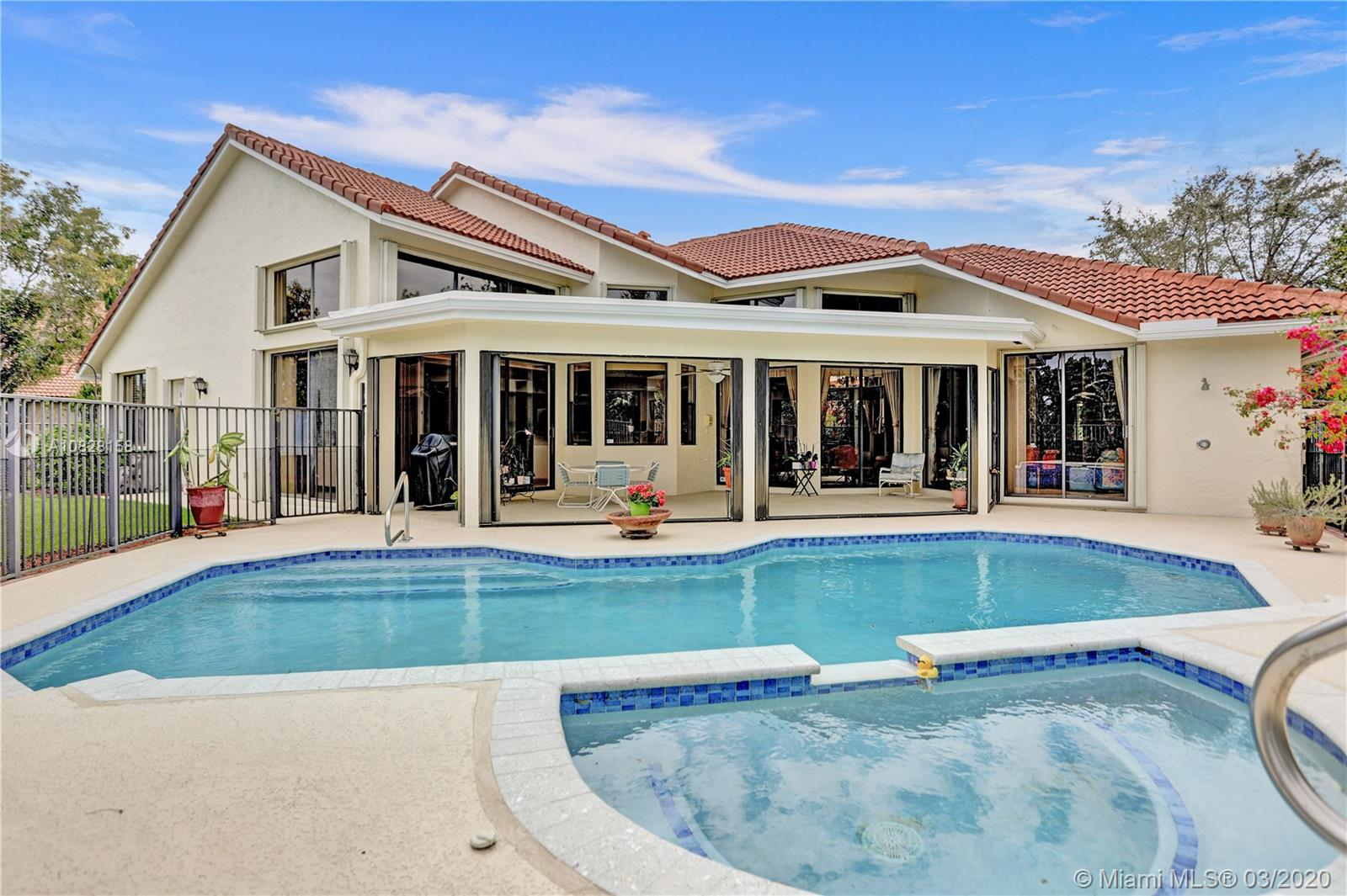 This meticulously maintained home with a gorgeous lake view is located in the esteemed guard-gated community of Palm Island. The high vaulted ceilings and large windows let the right amount of natural light enter throughout the home. The perfectly laid out split floor plan allows for a pool and lake view from the master suite and all entertaining areas. The large kitchen dawning granite countertops opens to the family room. The covered patio and enormous deck overlooking the heated pool, jacuzzi and panoramic lake views across from lush greenery is ideal for outside entertainment. Circular driveway w/ new impact doors on 3 car garage, accordion shutters throughout, NEW Roof in 2017, exterior and interior repainted in 2018. Great location, walking distance to A+ schools, parks and shopping.