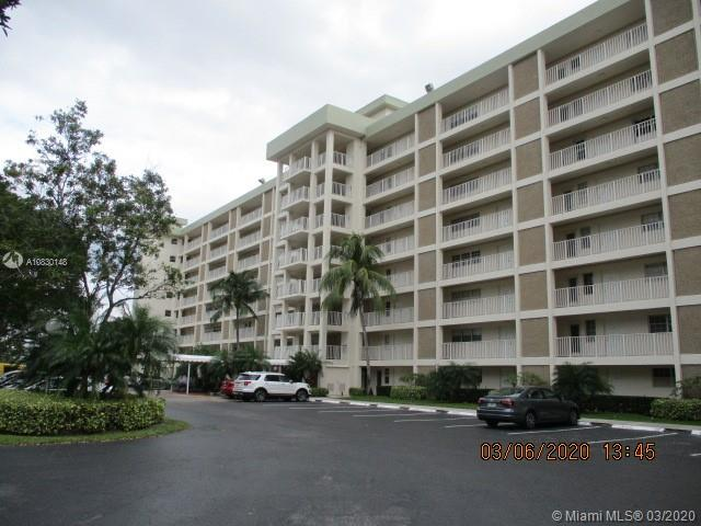 INCREDIBLE OPPORTUNITY on this large 3BR/2BA end unit with a water view AND Hurricane impact windows. Kitchen has wood cabinets & granite counters, upgraded bathrooms & large living-dining area w/great lake views. Palm Aire is a beautiful serene oasis with golf courses, miles of walking paths, BBQ area - yet you are just minutes from shopping, restaurants, and the Isle Casino & Racetrack. Ground floor w/tile throughout and a large screened patio. This is a Reverse Mortgage Property and the transaction is governed by HUD Guidelines for Offers, price reductions and repairs. The Seller does not pay for Owner's policy, transfer or recording fees. No Rentals are allowed during the first year of ownership. MLS info deemed reliable but should be verified. HOA requires Min 20% down if financing.