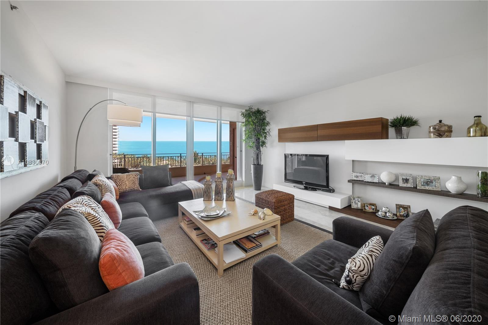Stunning ocean and bay views from this corner unit at premier Ocean Tower One. Unit features 3 Beds + Den + Staff quarters, 4.5 Baths and has been remodeled with a new Italian kitchen with European-style glass enclosure allowing you enjoy both ocean and bay views from every social area. Kitchen includes a new smart designed island and a very ample pantry. All new Italian doors, custom electric shades and blackouts in every bedroom, new wood type floor in all bedrooms, all crystal shower doors, custom closets. Absolute pristine condition. Offered furnished and ready to move in!  **SEE VIDEO IN VIRTUAL TOUR**