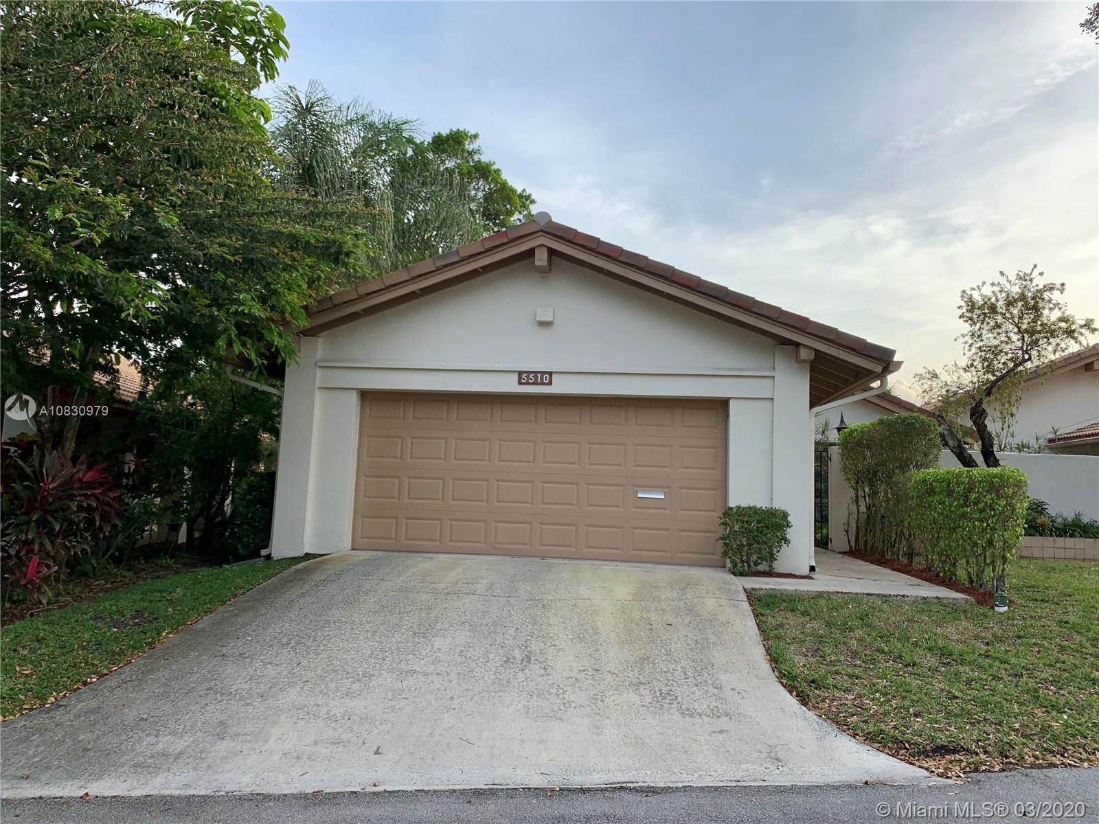 """Beautiful and spacious, spectacular lake view villa, in the subdivision of """"The Hills"""" at Inverrary. Home features roomy 2 bedroom 2 bath with a huge 2 car garage, accordion shutters, separate laundry room, vaulted ceilings, and beautiful natural lighting. Needs TLC, Don't miss this opportunity to own this charming villa."""