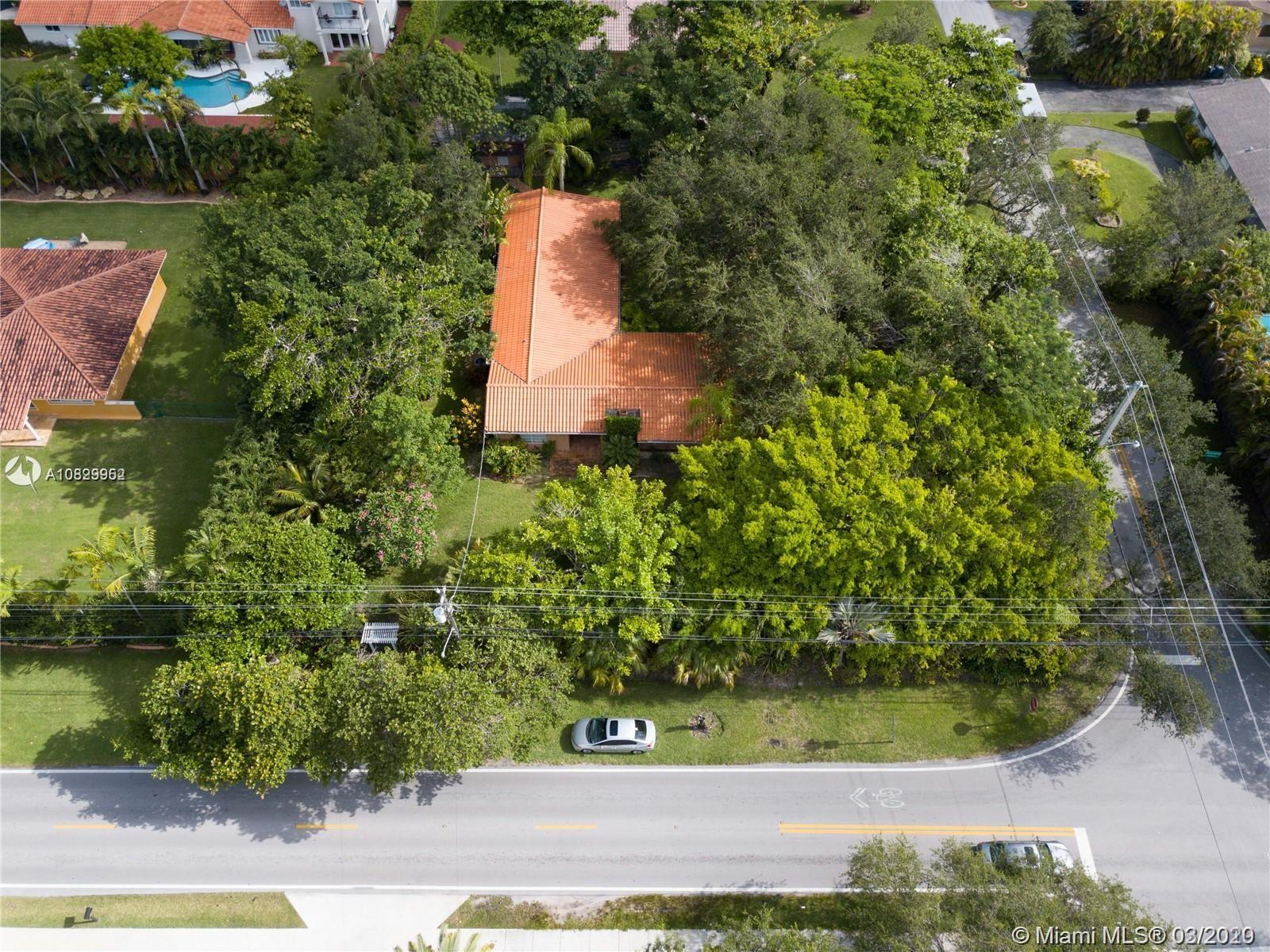 An amazing 27,056 sq ft corner lot land on 59 Ave. and 80 St. east of US1 in the beautiful City of South Miami. Ideal for an investment large enough to build two homes or to build your dream home. Close to lots of what the area has to offer including great schools, hospitals, entertainment, outdoor activities, and shopping. Being on a corner gives you the option to make the main entrance of the property either on SW 80th St. or 59th Ave. There is an existing house now in great condition. Rare opportunity for this size lot in a lovely part of South Miami. Currently rented until March 2021. Please do not disturb tenants.