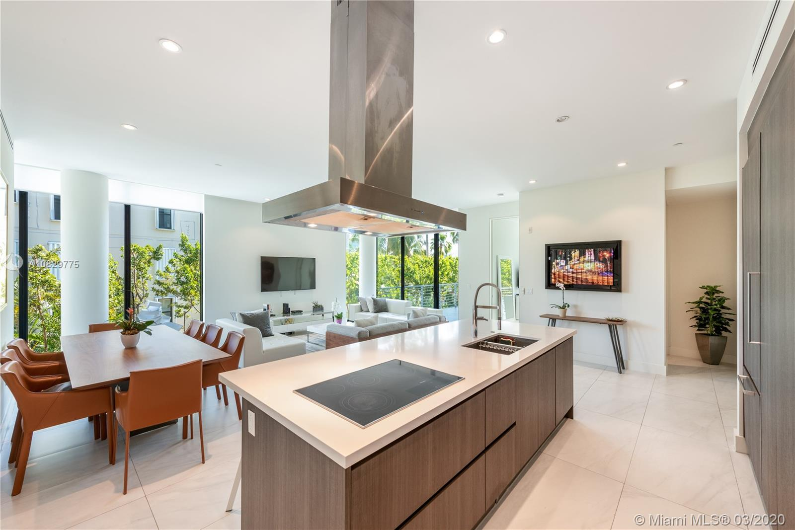 This spacious corner unit spans 2,201 sf comprised of 3 bedrooms, 3/1 baths with an open floor plan that offers plenty of natural light from 11 ft floor-to-ceiling windows and doors throughout. Kitchen includes Miele appliances and white quartz countertops. Large open balcony with wet bar for al fresco dining. Clean Contemporary architecture can be found throughout this completely gated and walled urban boutique building located in the heart of Key Biscayne. Amenities include gym, roof top lap pool, barbecue area and sundeck. Laundry room in unit. 2 parking spaces and storage. A perfect winter retreat destination.