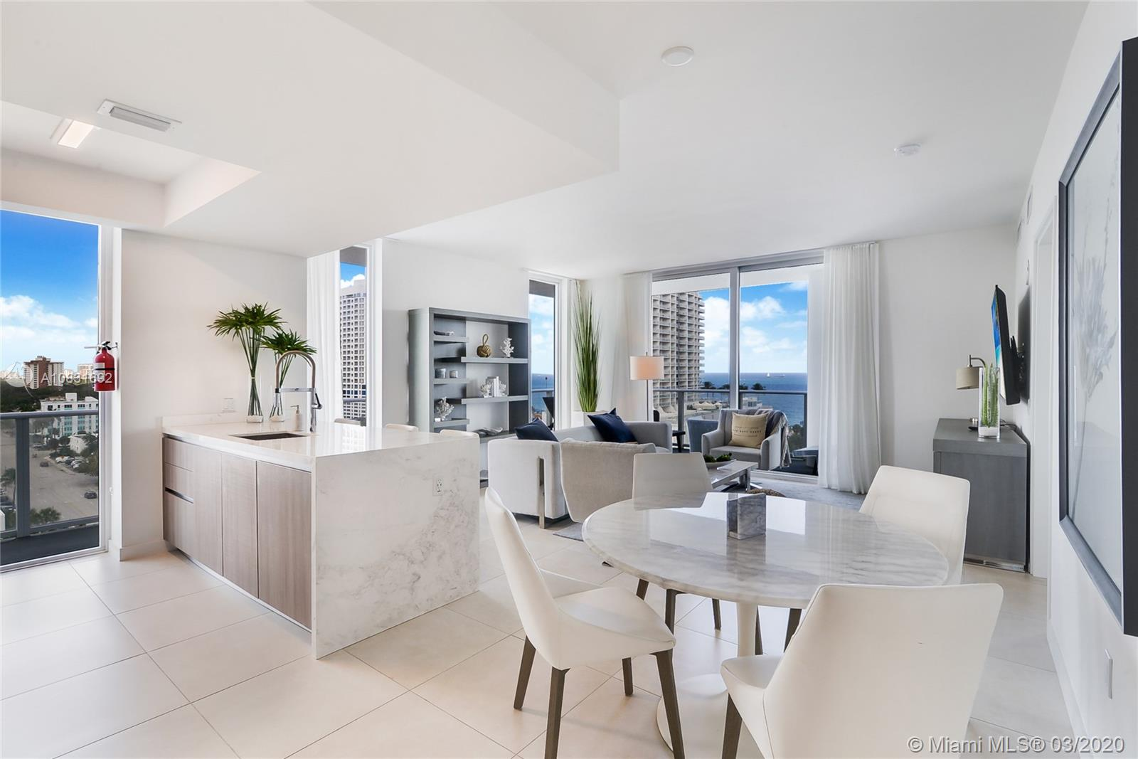 Welcome to this beautiful, sun-filled corner unit, located on the lower penthouse at Tiffany House/Gale. The unit boasts a split floor plan, 2 ensuite bedrooms and a spacious den, marble master bathroom with separate tub and shower, high end appliances, quartz countertops and floor to ceiling impact windows. The wrap around balcony offers beautiful Ocean and Intracoastal views.  This turnkey unit comes fully furnished by renowned designer Steven G and is completely move-in ready.  Occupy full time or part time and rent it when not in use as the building has no rental restrictions.  Convenient location just 1 block from world renowned Fort Lauderdale Beach, close to Las Olas Blvd, Ft Lauderdale Intl. Airport and Port Everglades make this a highly sought after destination.