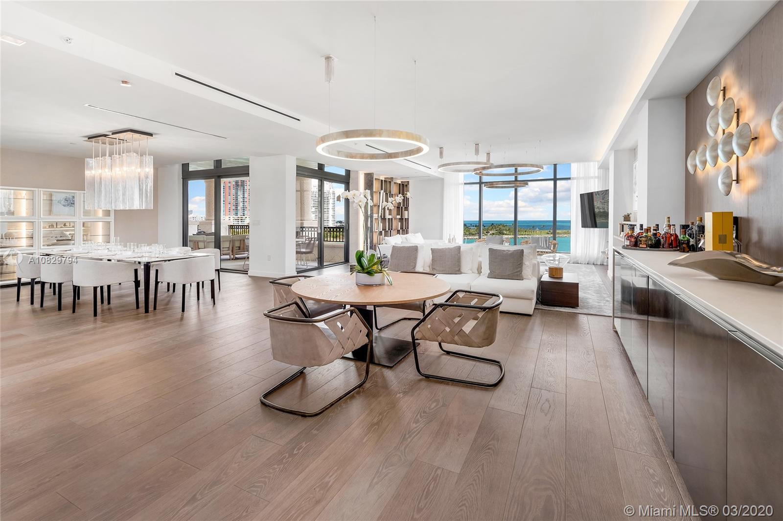 This turnkey, fully furnished designer unit by Henge at Palazzo Del Sol, the new luxury building on Fisher is stunning. No expense spared. This unit features 3,793 SF, private elevator entry, oak floors throughout, custom wallpapers, lighting, millwork & built-ins. Spacious open flow-thru layout w/extended living, family & dining areas with amazing views to Govt. Cut, city & Ocean. The chic gourmet Boffi kitchen sports top-of-the-line Gaggenau appliances & exotic stone counter tops/backsplash. A private principal suite offers direct terrace access & water views, & Book-Matched Statuario marble bath with walk-in glass-marble rain shower & sunken oval tub. The other 2 bedrooms w/en-suite baths & a shared terrace w/views to Fisher Island & Miami skyline. 5-Star Palazzo Del Sol amenities.