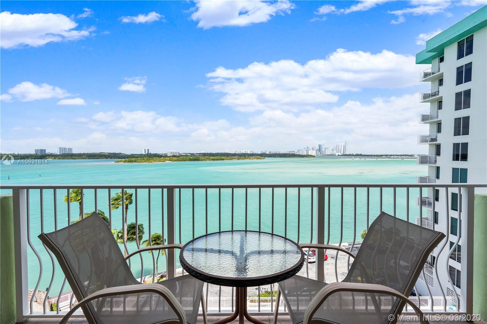 Rare Opportunity to own this double unit with DIRECT VIEWS of Biscayne Bay from every room! 1,900 sqft w/ two separate balconies. Spacious master bedroom with oversized walk in master closet. Master bedroom has private balcony. Large kitchen with granite counter tops & tons of cabinet space. Tile throughout. Washer & dryer in unit. Unit comes with 2 parking spaces as well as 2 AC'd storage units. Impact windows. Building has lots of amenities: Heated pool, large gym, media room, tiki huts & gas grills, 24 hour front desk attendant and on-site management. Boat slips available for rent through association. Gated property. Common areas remodeled in 2018. Premium cable & internet included in HOA. Cooling tower & chiller system for air conditioning,  electric bills are lower. Walk to A+ school