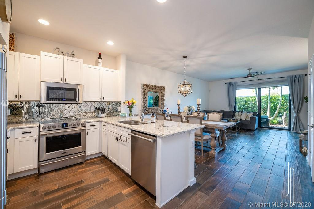 Beautifully updated townhome conveniently located minutes to Beaches, Downtown, Wilton Manors, Shopping, Dining & Major Highways.  Attention to Detail can be seen throughout.  Porcelain wood plank tile flooring.  Upgraded stainless steel appliances. Private landscaped paver patio w/Weber grill.