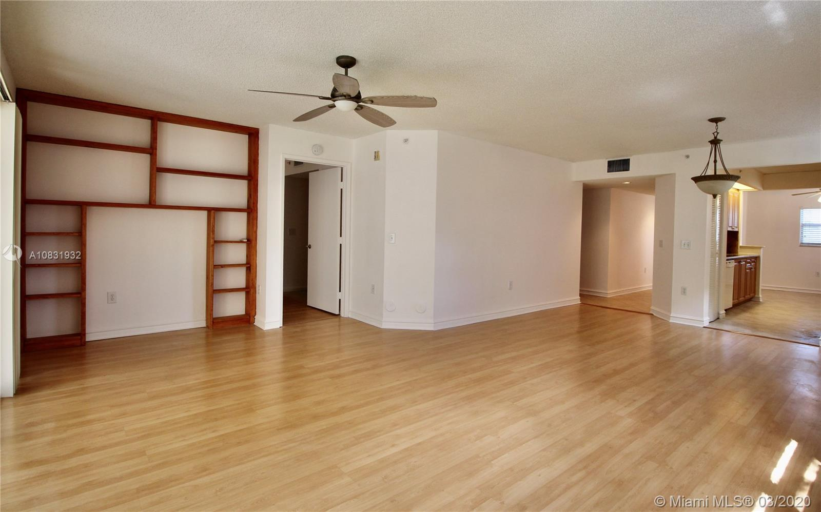 Spacious and renovated 2 bedroom condominium with exceptional amenities. This unit is located in Century Village of Pembroke Pines, a 55+ community. Corner unit on the first floor, with easy access. Features include ceramic and wood flooring, granite countertops, and tile finishes throughout the home. A bright breakfast room leads into the kitchen with a spacious living area. Enjoy our beautiful Florida weather from your screened-in patio. Walk in closets, in-house washer and dryer, and ample storage space makes for ultimate convenience. The master bath features a beautiful mirrored vanity and all bathrooms are handicapped accessible. A/C replaced and updated appliances in the kitchen. Second bedroom has a private bathroom entrance and is perfect for guests coming to visit.