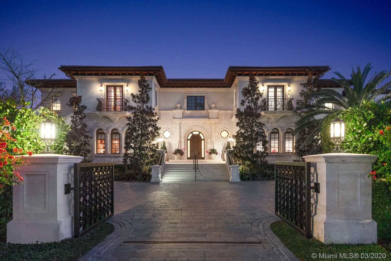Located on the water's edge in Gables Estates on a 42,253 sf lot facing a wide lagoon with direct bay access, this luxurious 15,522 total sf, 5BR/7+3BA palladian waterfront villa comes with picturesque views from several sitting areas. Downstairs are the formal living room, dining room, gourmet kitchen, breakfast room, family room with wet bar, and billiards room with a second bar, all with custom Venini glass lighting. The kitchen comes with a hidden butler's kitchen and walk-in wine cellar for an equally impressive collection. Two home offices can be converted into additional bedrooms, and secret storage spaces are scattered throughout. Summer kitchen, saltwater heated pool, 180 ft dock with boatlift and ideal water features enhance this inviting home for both entertaining and leisure.