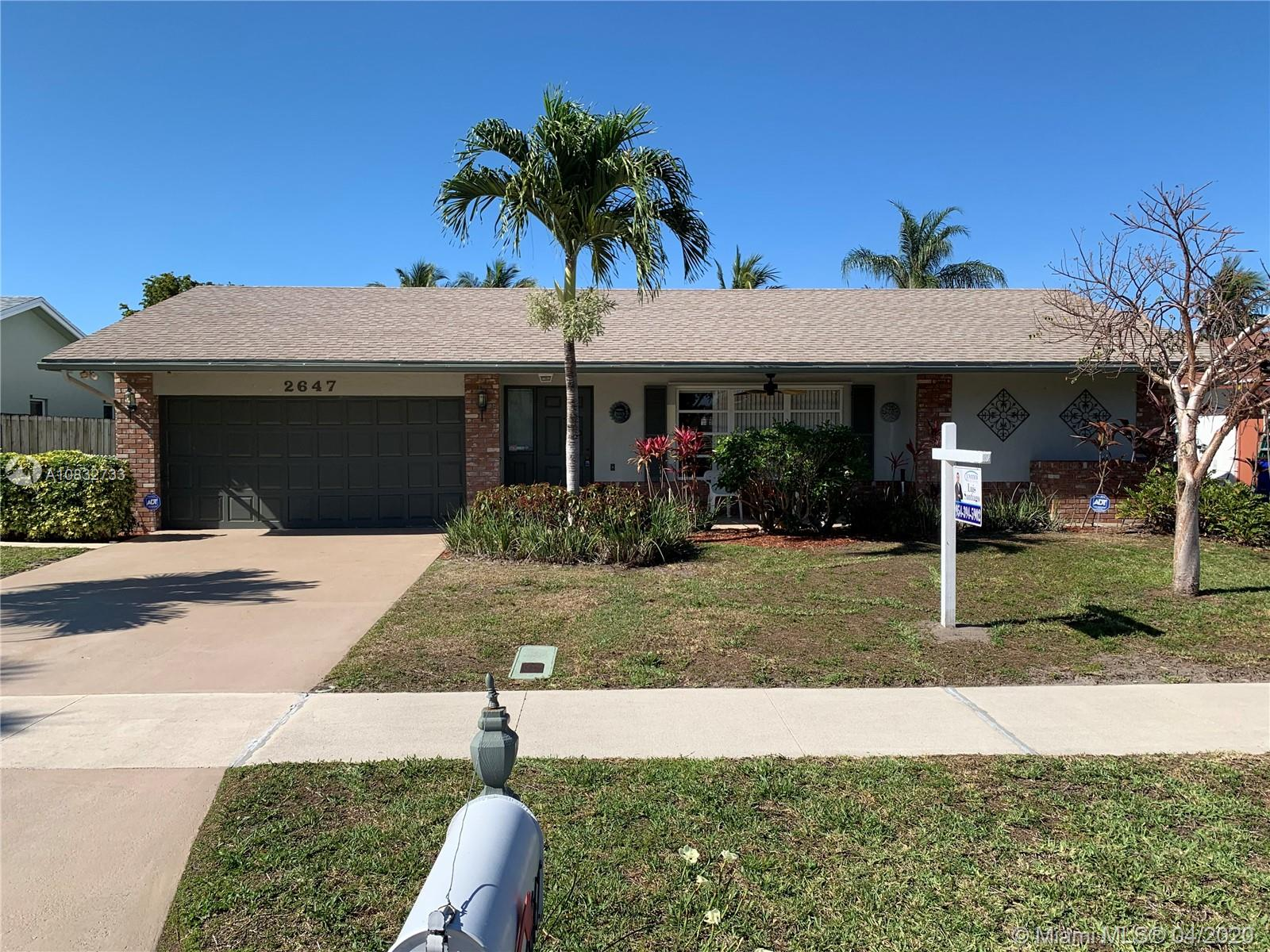 BRAND NEW ROOF JUST INSTALLED!! THIS ONE IS THE POPULAR GORHAM MODEL, (ONLY MODEL WITH A SPLIT BEDROOM PLAN). THIS HOME FEATURES A FLORIDA ROOM WITH A/C AND HEAT, GARAGE ALSO UNDER AIR, INSIDE LAUNDRY ROOM, OPEN KITCHEN WITH BREAKFAST AREA AND SEPARATE DINING AREA, READY FOR THE FAMILY TO MOVE IN. BACK YARD FEATURES A PATIO. WINDOWS HAVE SHUTTERS AND STORM BUSTERS FOR PROTECTION. FRONT OF THE HOUSE FEATURES A COVERED SEATING AREA THAT IS PAVED. BIG ENOUGH FOR THE FAMILY, LOCATED IN DEERFIELD BEACH CLOSE TO SHOPPING, HIGHWAYS , THREE LARGE NEIGHBORHOOD PARKS AND MORE. NO HOA!