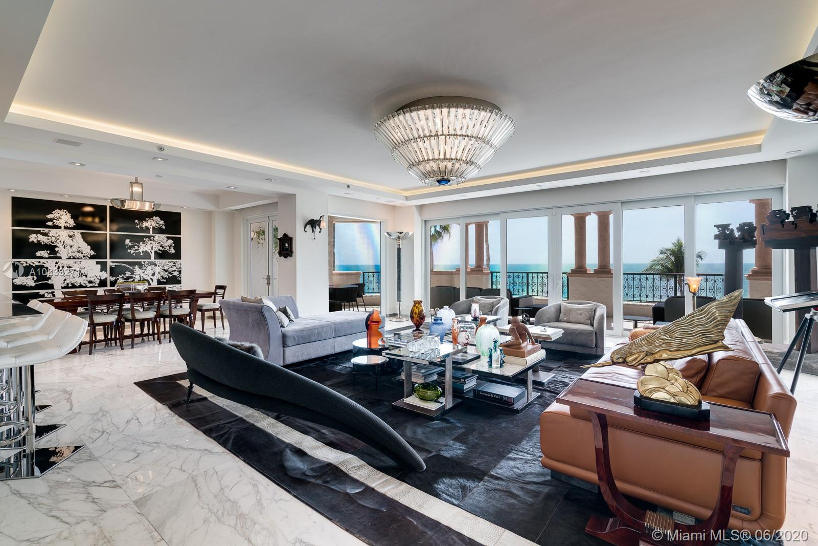 Unwind to breathtakingly peaceful direct ocean views. Oceanside Fisher Island has been masterfully renovated to accommodate the most exquisite tastes.  Two gorgeous bedroom suites, guest half bath, additional living space artistically integrated into a personal gym and opulent foyer. This unique layout now offers 2,830 SQFT as per owners assessment. Parking for 2 cars & 1 golf cart. Impressive amenities includes world-class golf, marina, tennis facilities, private school and access to famous Fisher Island Club.