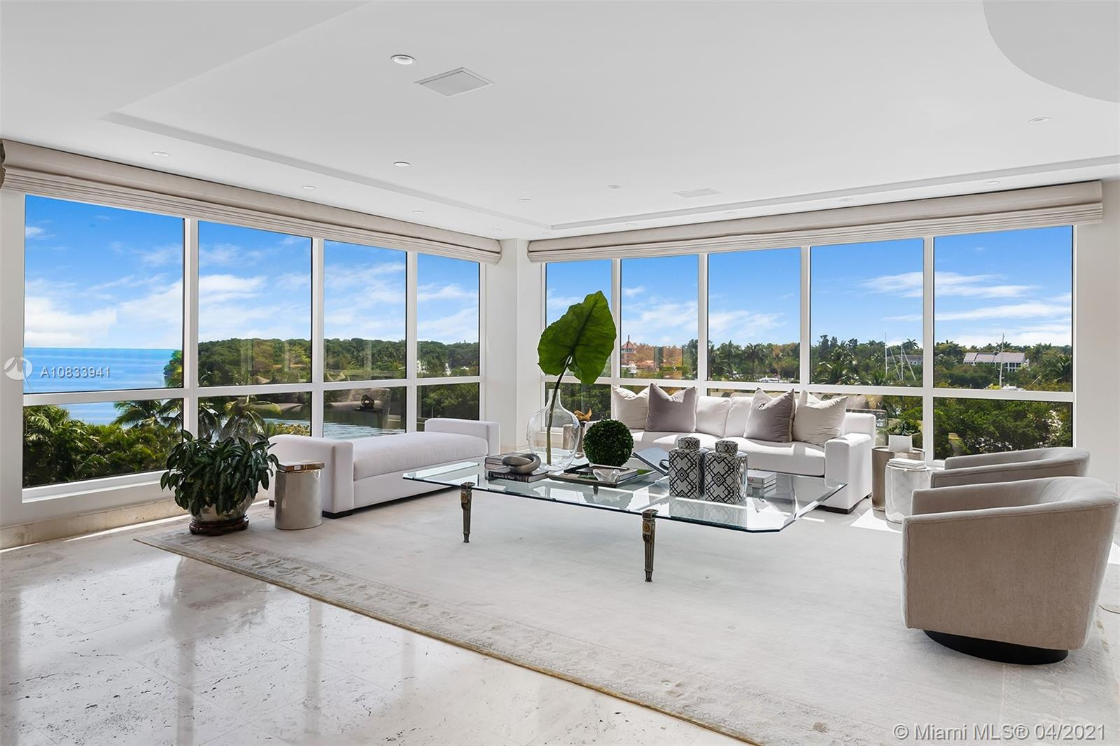 """7,600sf of pure elegance awaits the new owner of this unique, combined """"A"""" line unit in the prestigious and well located Gables Club complex. With direct views of the Miami skyline and Biscayne Bay, this unit offers a rare opportunity to really """"have it all"""" at one's fingertips: full service concierge, on-site bar/restaurant, gym/spa/beauty salon, tennis courts, putting green, heated pool, marina, 24hr security and valet parking.  This is convenient and worry free living at its best. Originally configured as a 6 bedroom unit, it currently has 4 bedrooms plus a gym/playroom and a library/office/den. Encompassing two floors with an elevator as well as a stunning interior connecting staircase, this waterfront luxury home in the sky represents the epitome of luxurious, care free living."""