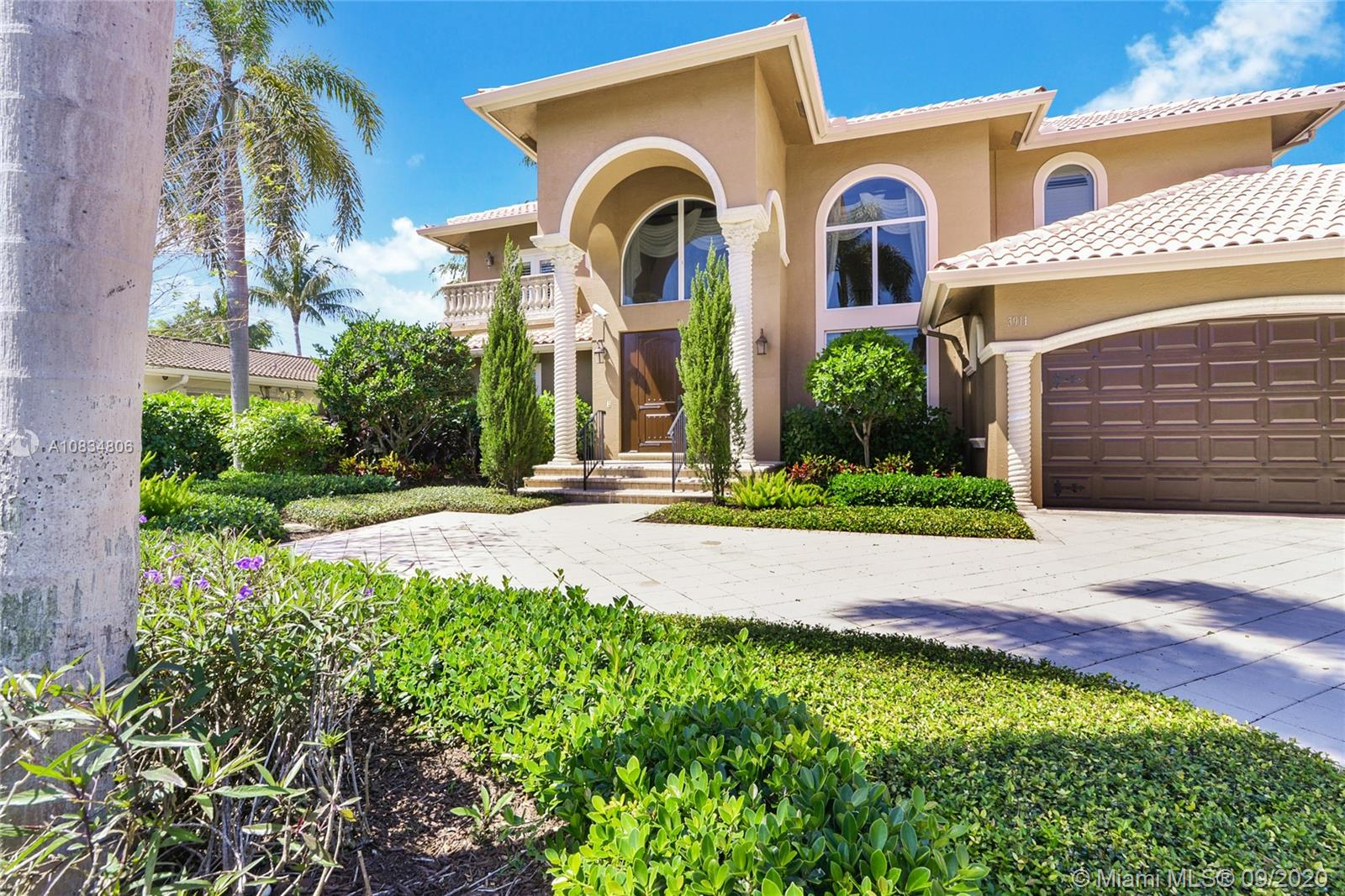 Beautiful home in the highly desirable Venetian Isles section of Lighthouse Point with East exposure. A boater's paradise with protected dock, and no bridges to intracoastal Waterway. Wonderful pool, spa and backyard. Custom built in 2000, this five-bedroom, four & one half bath home is filled with light and open spaces for family living. Marble floors downstairs & handsome hardwood floors upstairs. Impact windows and doors throughout. Eat-in gourmet kitchen with top-of-the-line Thermador appliances and custom cabinetry opens to large family room. There is a large en-suite main bedroom downstairs and a second en-suite bedroom upstairs with 3 additional bedrooms. All have lovely water views! Completing the home is a large laundry room and a full 3-car garage. 24-hour to show please.