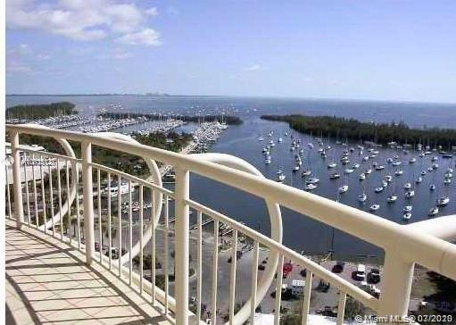 Unique property at Grove Towers' two story PH w/private roof deck & 270-degree of Totally unobstructed Ocean and bay views!  2500 SF of wraparound balconies accessible from every room on both floors.  Make it your own! Ready to be remodeled at your own taste.  Full service condo w/24-hr. doorman, valet & pool/tennis/fitness, Prime location along the Marina & steps to CocoWalk.  We offer seller financing! Unit is vacant and easy to show!