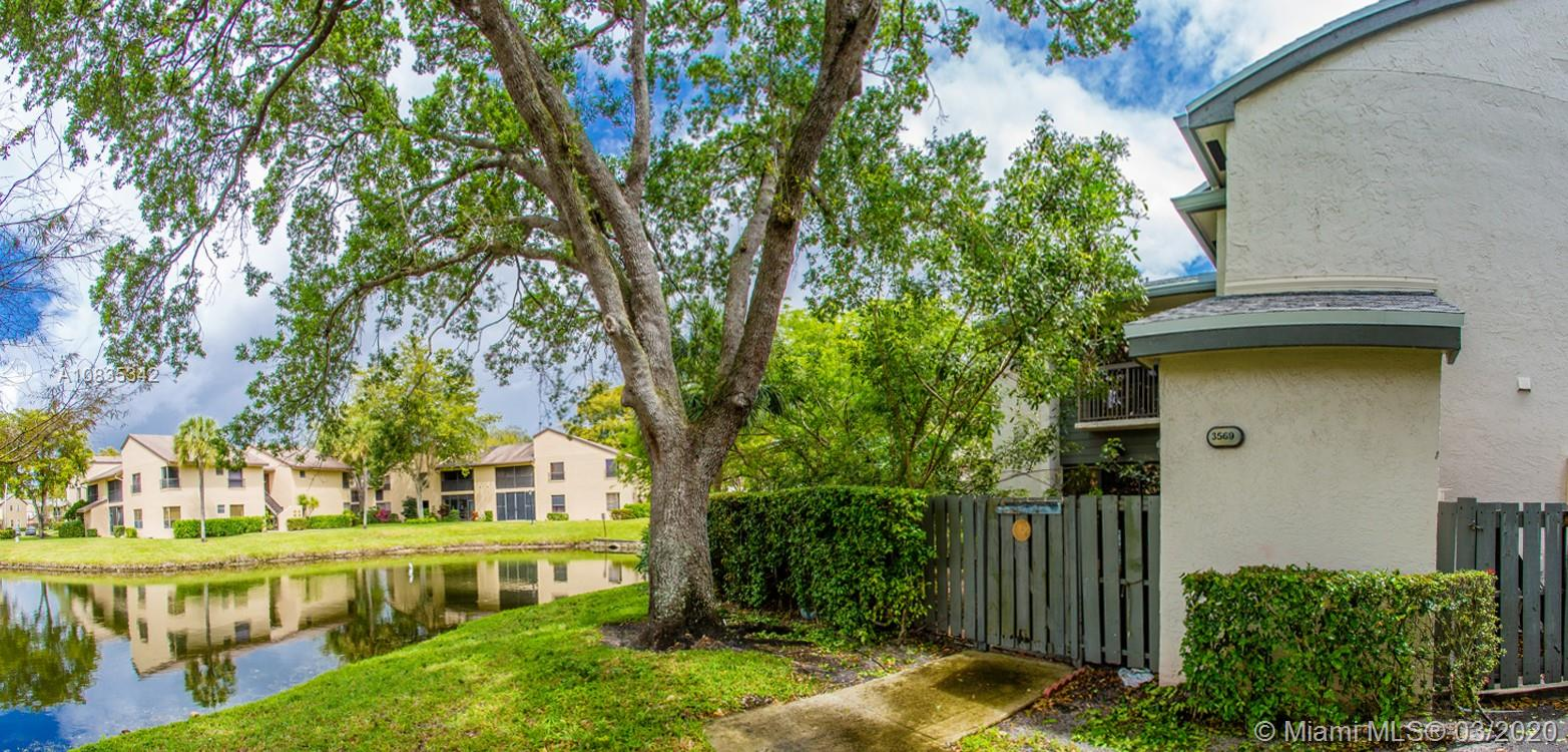 Beautiful water view from this 2/2.5 in Coconut Creek! Property features ceramic tile floors in living areas, updates in kitchen and baths, washer/dryer, large private patio and so much more. Make this your home today!