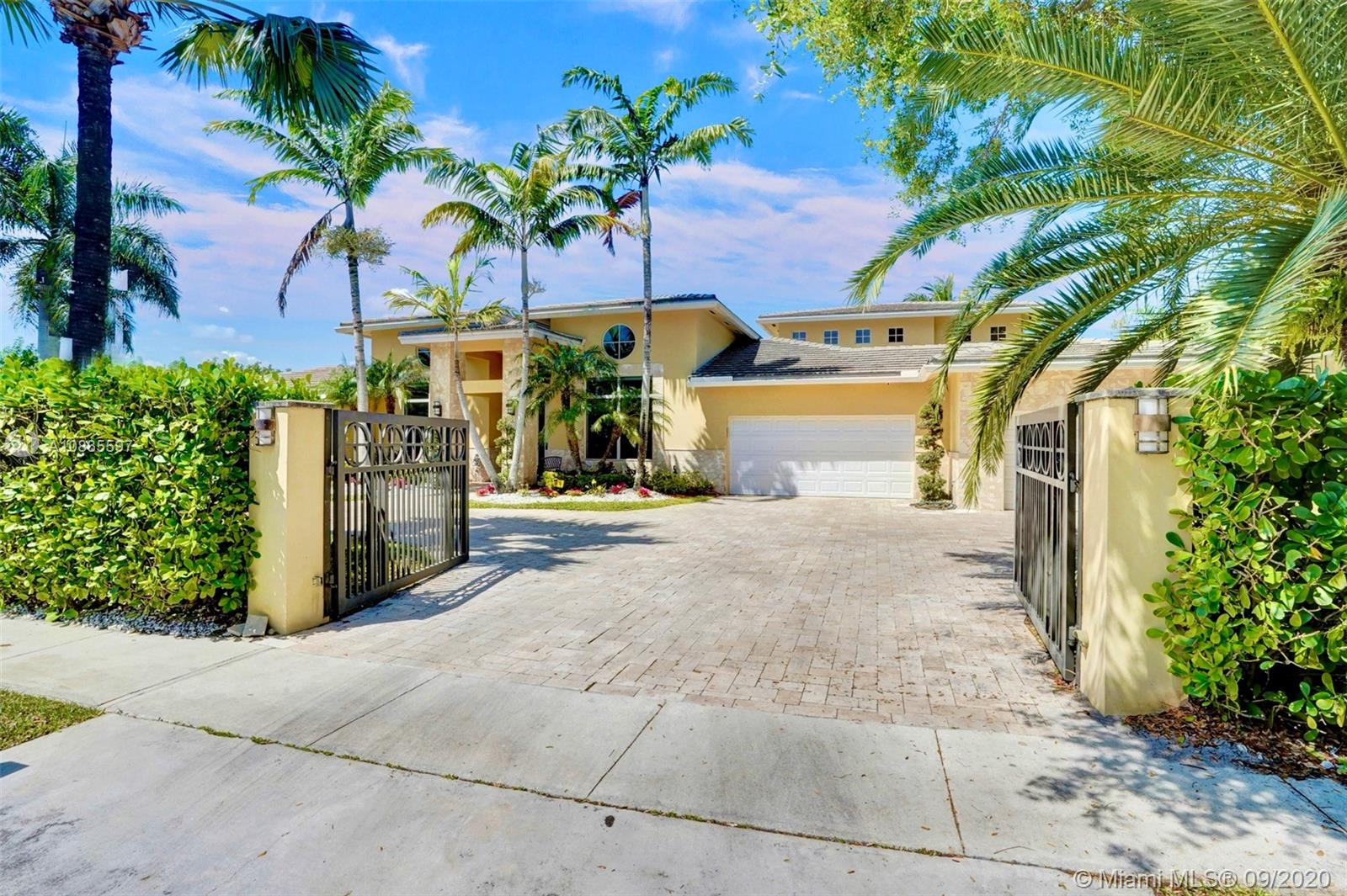 SOUTH FLORIDA LIVING AT HIS FINEST IN THIS ELEGANT UNIQUE MASTERPIECE THAT SEATS BEHIND GATES IN A PRIVATE WATERFRONT PRESERVE. NEWER OPULENT OVERSIZED SWIMMING POOL, STUNNING SUMMER KITCHEN, COVERED EXPANSIVE & EXPENSIVE MODERN PATIO, HIGH IMPACT WINDOWS, SMART HOME FEATURES, VERY OPEN MODERN SPACIOUS FLOOR PLAN LAY OUT, DECORATIVE WOODEN PANNEL WALLS, PROJECTOR MONITOR TV, MARBLE FLOORS IN MAIN LIVING AREAS, WOOD FLOORS IN ALL BEDROOMS, LARGE KITCHEN W/STAINLESS STEEL APPLIANCES, FORMAL DINNING ROOM, MAJESTIC FAMILY ROOM W/SWEEPING WOODEN CEILINGS, LARGE MASTER BEDROOM, LUXURIOUS MASTER BATHROOM, JETS, HOT TUB, MARBLE, UNIQUE DETAILS, BOOSTING 5 BEDROOMS, 5 BATHROOMS, PRIVATE OFFICE, 3 CAR GARAGE AND MANY MORE DETAILS INCLUDING LUSH LANDSCAPING. CALL TODAY FOR PRIVATE SHOWINGS.